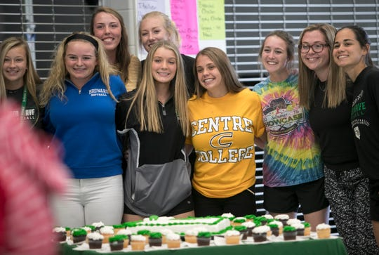 Sawyer Lecius poses for a photo with her softball teammates from Fort Myers High School during the Signing Day ceremony. Lecius signed to play softball for Centre College.