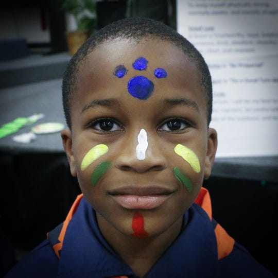 Julian Ellis Jr. with his face painted at a cub scout meeting.