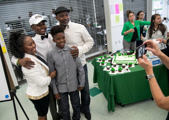 Milan Tucker poses for a photo with his mom Azuree'D, dad Michael, and younger brother Madrid after he signed to play football with Appalachian State University on Wednesday, Feb. 6, 2019, at Fort Myers High School.