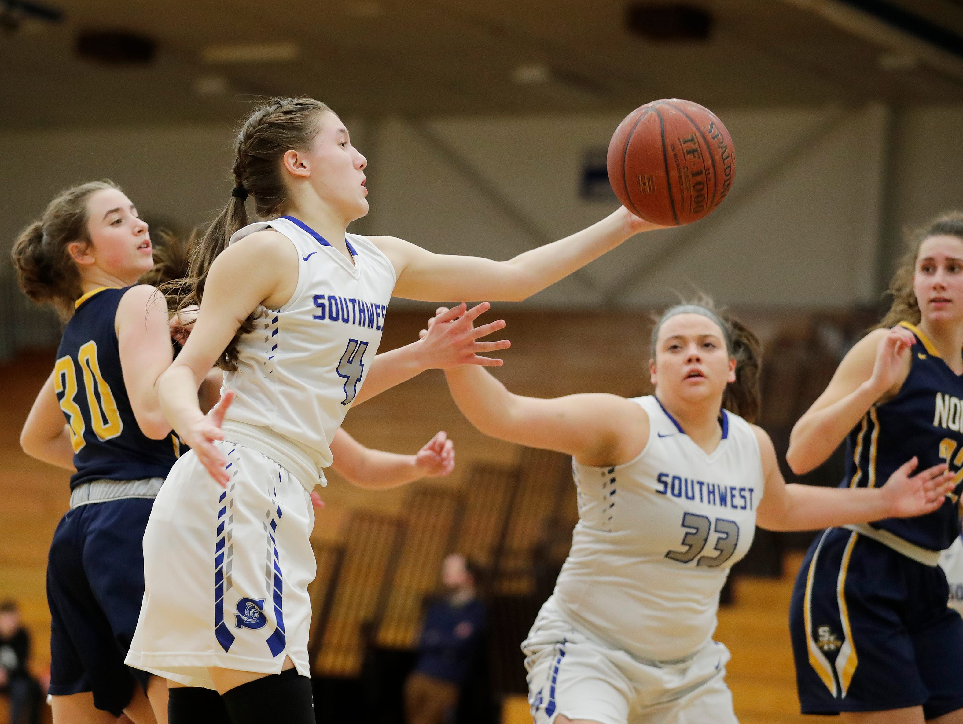 Green Bay Southwest's Caitlyn Thiel (4) grabs a rebound against Sheboygan North in a girls basketball game at Southwest High School on Tuesday, February 5, 2019 in Green Bay, Wis.