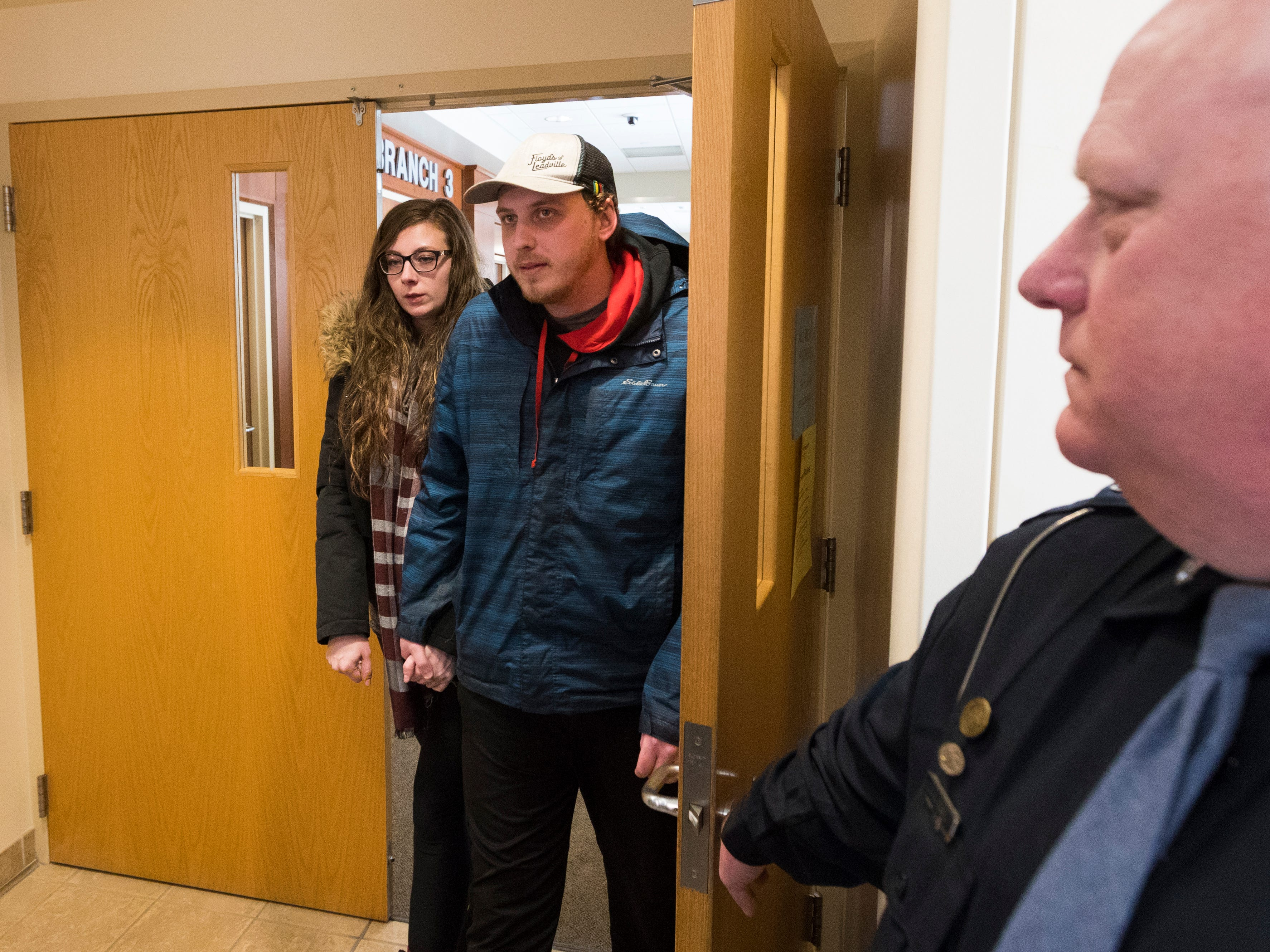 Erik Patterson and his sister, Katie, siblings of Jake Patterson, leave following a court appearance by their brother Wednesday, February 6, 2019 at the Barron County Justice Center in Barron, Wis.  Patterson is charged with the murders of Denise and James Closs and the kidnapping of their 13-year-old daughter, Jayme, who escaped after 88-days being held captive.