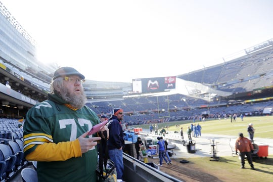 Russell Beckman watches Green Bay Packers and Chicago Bears players warmup from the stands at Soldier Field on Sunday, December 16, 2018 in Chicago, Illinois. Adam Wesley/USA TODAY NETWORK-Wis