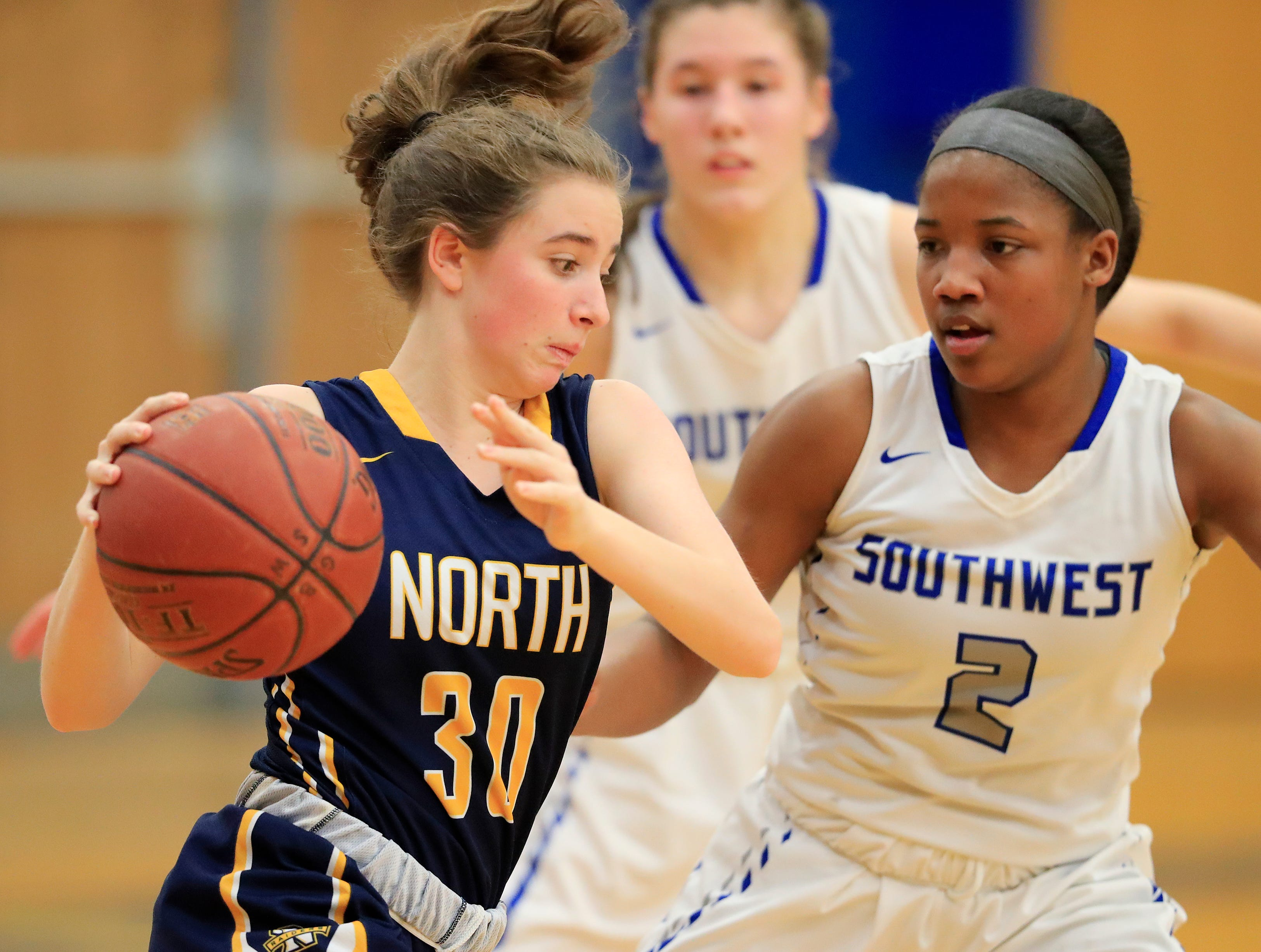 Sheboygan North's Karsyn Bichler (30) dribbles against Green Bay Southwest's Jaddan Simmons (2) in a girls basketball game at Southwest High School on Tuesday, February 5, 2019 in Green Bay, Wis.