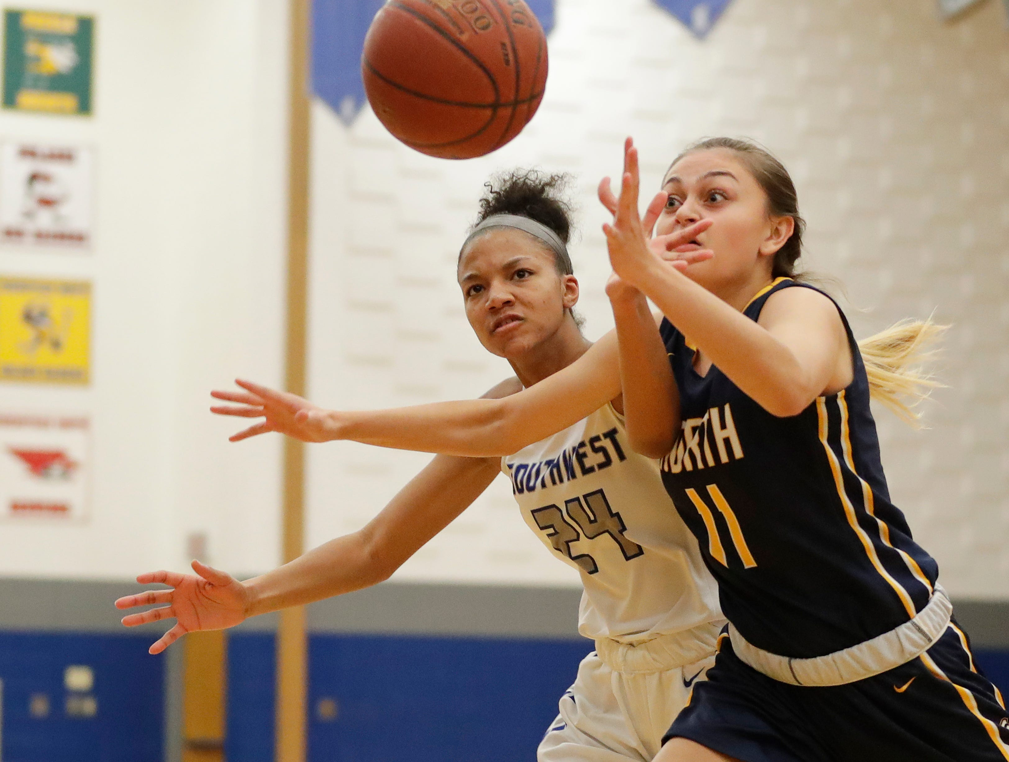 Green Bay Southwest's Jahzmeen Jackson (24) runs after a loose ball against Sheboygan North's Alycia Herr (11) in a girls basketball game at Southwest High School on Tuesday, February 5, 2019 in Green Bay, Wis.