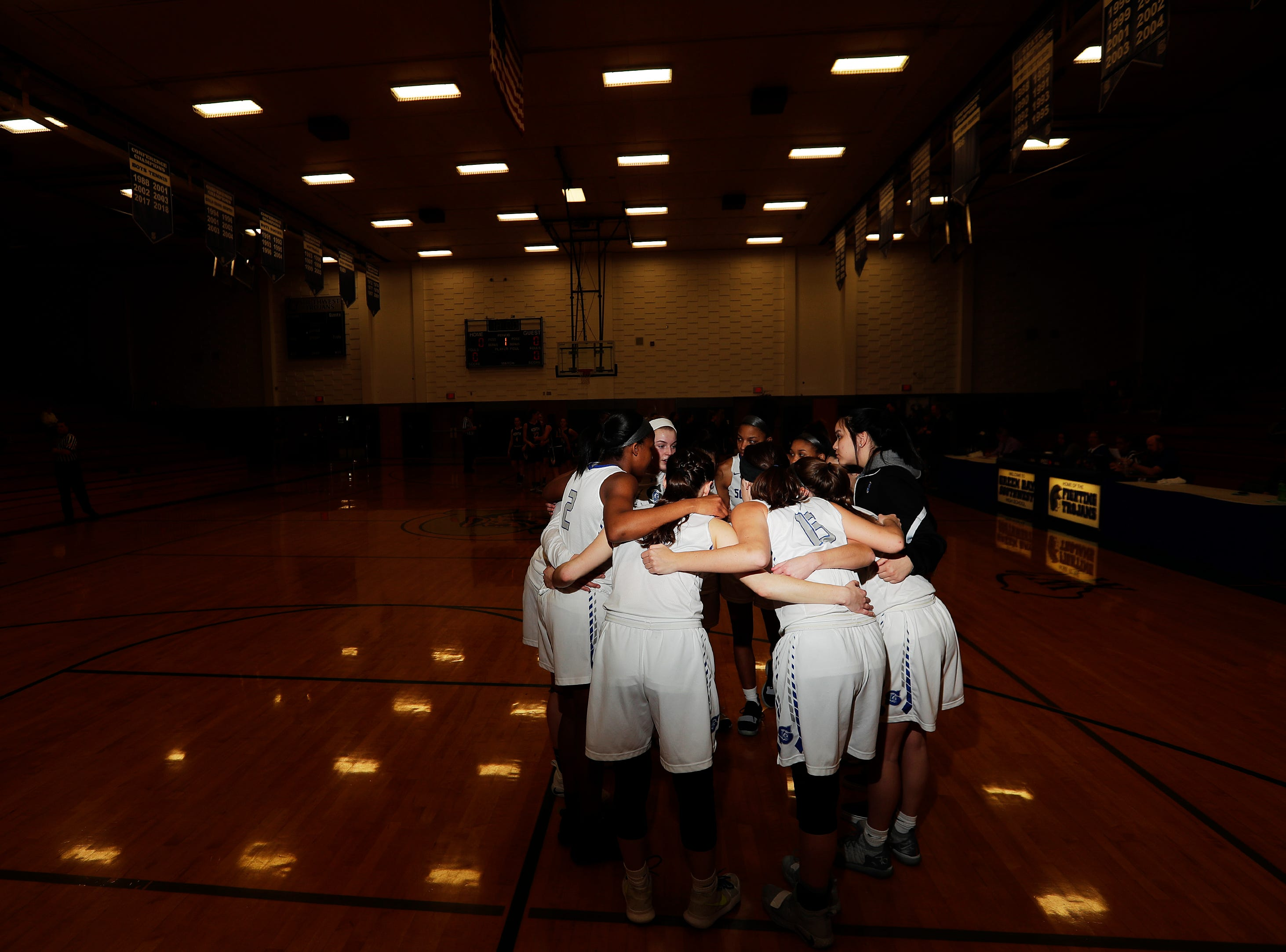 Green Bay Southwest players huddle before a girls basketball game at Southwest High School on Tuesday, February 5, 2019 in Green Bay, Wis.