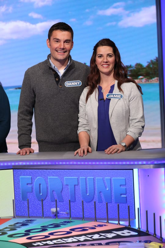 "Danny and Jamie Allen of Algoma on the set of ""Wheel of Fortune."" The couple competed on the syndicated game show in a taping in December that will air locally Friday, Feb. 8."