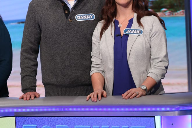 """Danny and Jamie Allen of Algoma on the set of """"Wheel of Fortune."""" The couple competed on the syndicated game show in a taping in December that will air locally Friday, Feb. 8."""