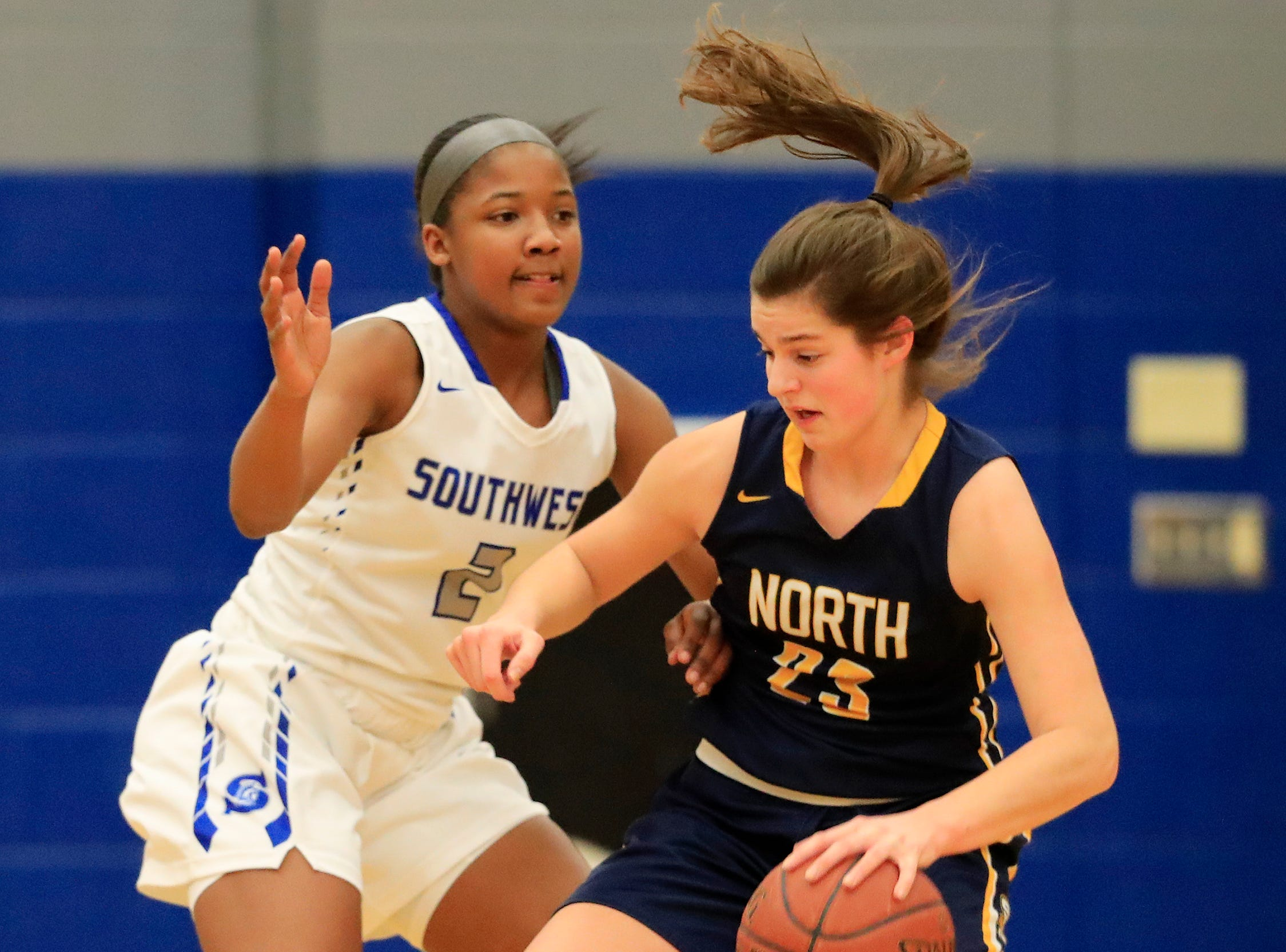 Green Bay Southwest's Jaddan Simmons (2) guards Sheboygan North's Meredith Opie (23) in a girls basketball game at Southwest High School on Tuesday, February 5, 2019 in Green Bay, Wis.