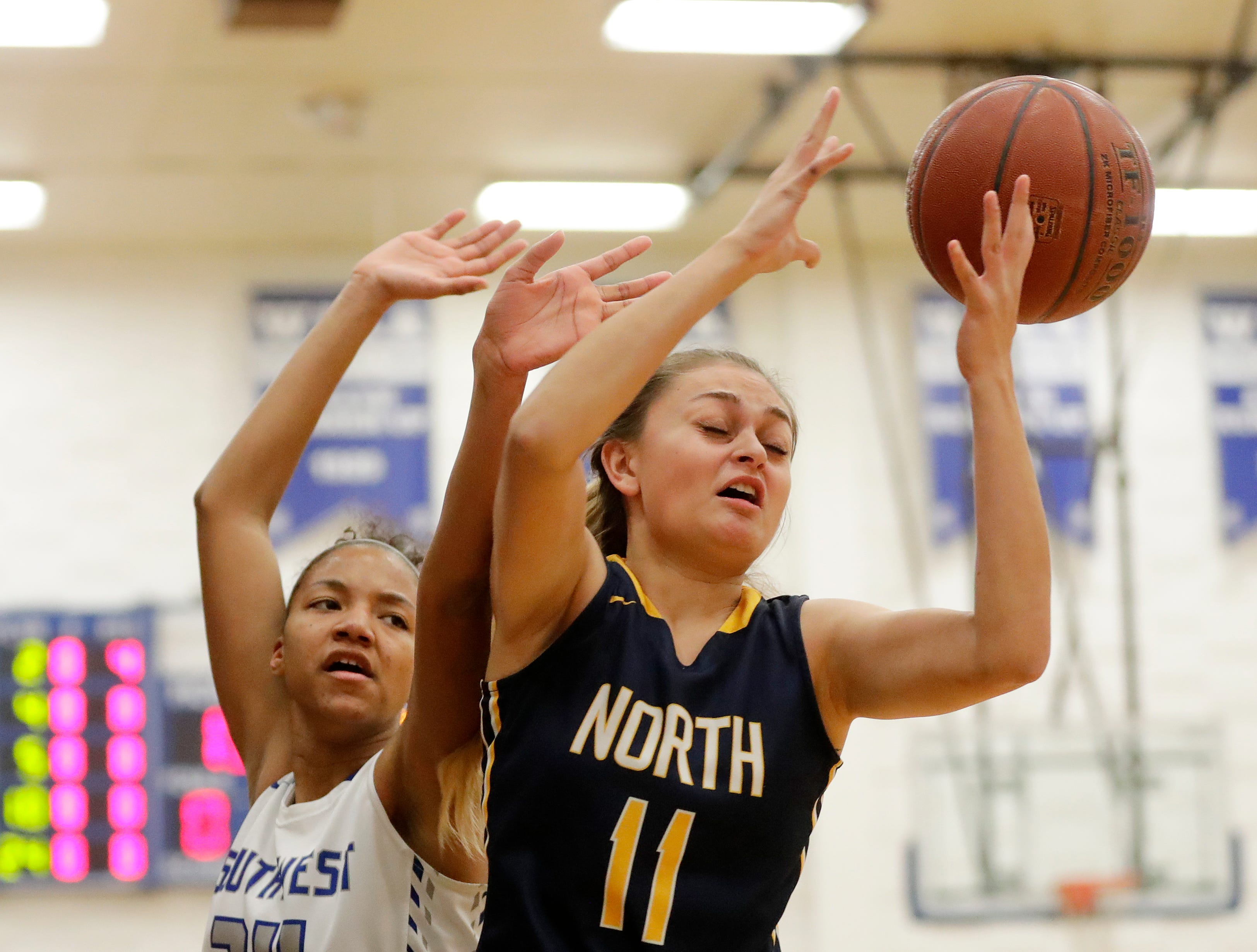 Green Bay Southwest's Jahzmeen Jackson (24) and Sheboygan North's Alycia Herr (11) compete for a loose ball in a girls basketball game at Southwest High School on Tuesday, February 5, 2019 in Green Bay, Wis.
