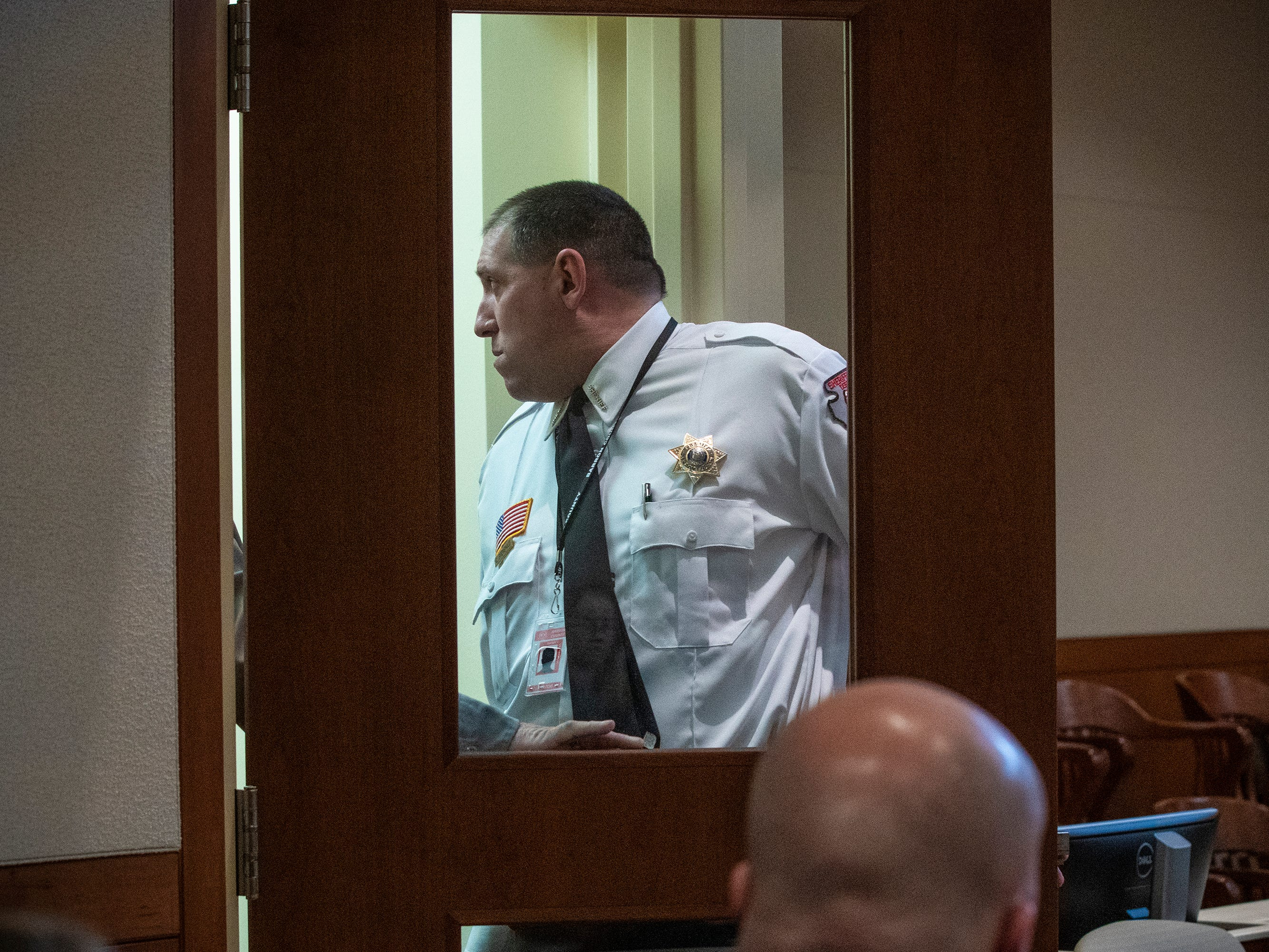 Barron County Sheriff Chris Fitzgerald checks the entrance where Jake Patterson will be escorted to his preliminary hearing Wednesday, Feb. 6, 2019, at Barron County Circuit Court in Barron, Wis. Patterson is accused of kidnapping 13-year-old Jayme Closs and killing her parents, James and Denise Closs, at their home on  Oct. 15.