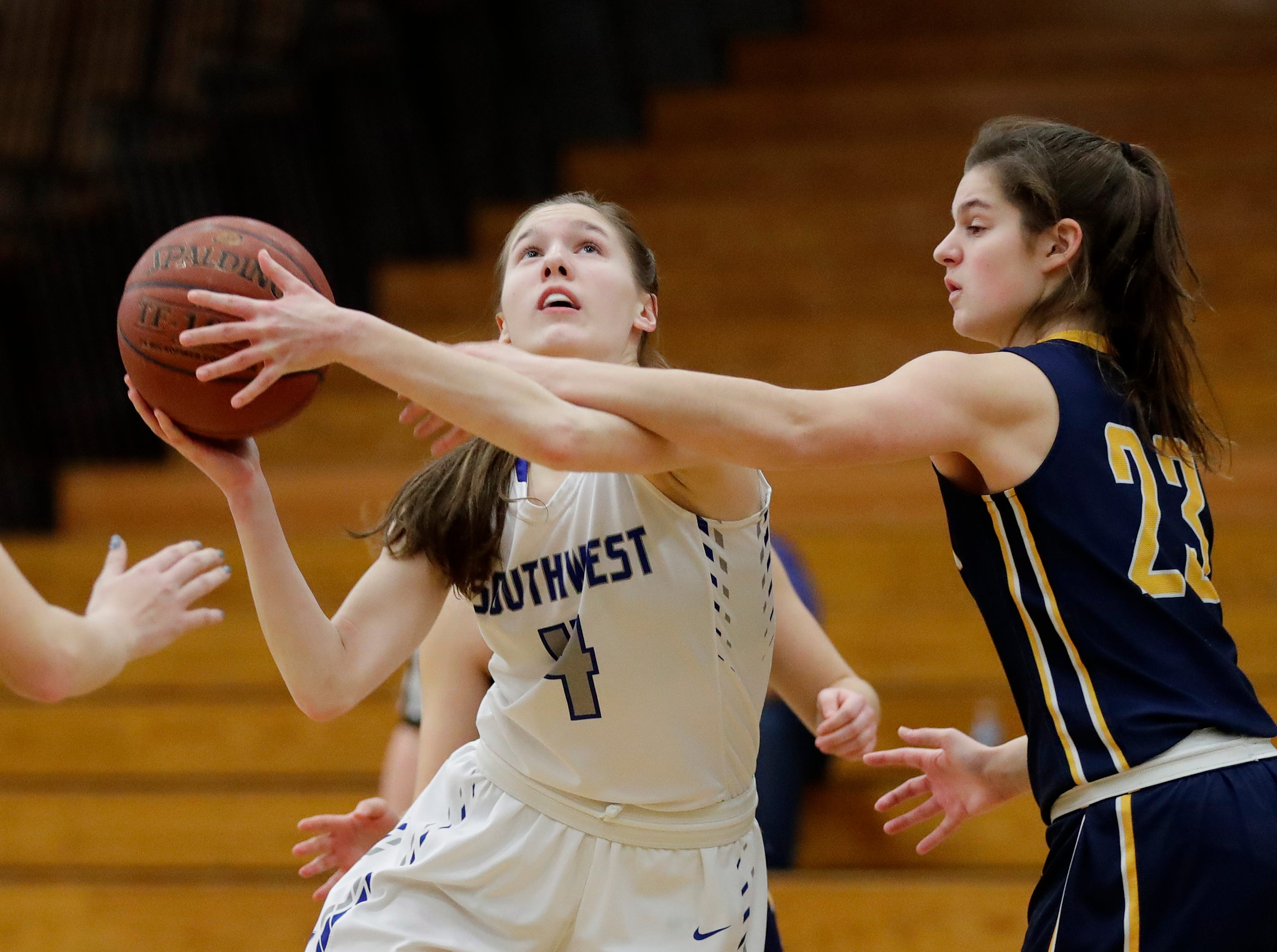 Green Bay Southwest's Caitlyn Thiel (4) shoots against Sheboygan North's Meredith Opie (23) in a girls basketball game at Southwest High School on Tuesday, February 5, 2019 in Green Bay, Wis.