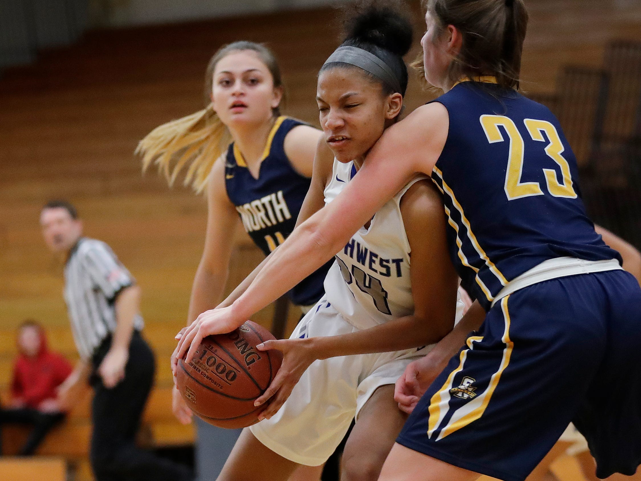 Green Bay Southwest's Jahzmeen Jackson (24) works against Sheboygan North's Meredith Opie (23) in the paint in a girls basketball game at Southwest High School on Tuesday, February 5, 2019 in Green Bay, Wis.