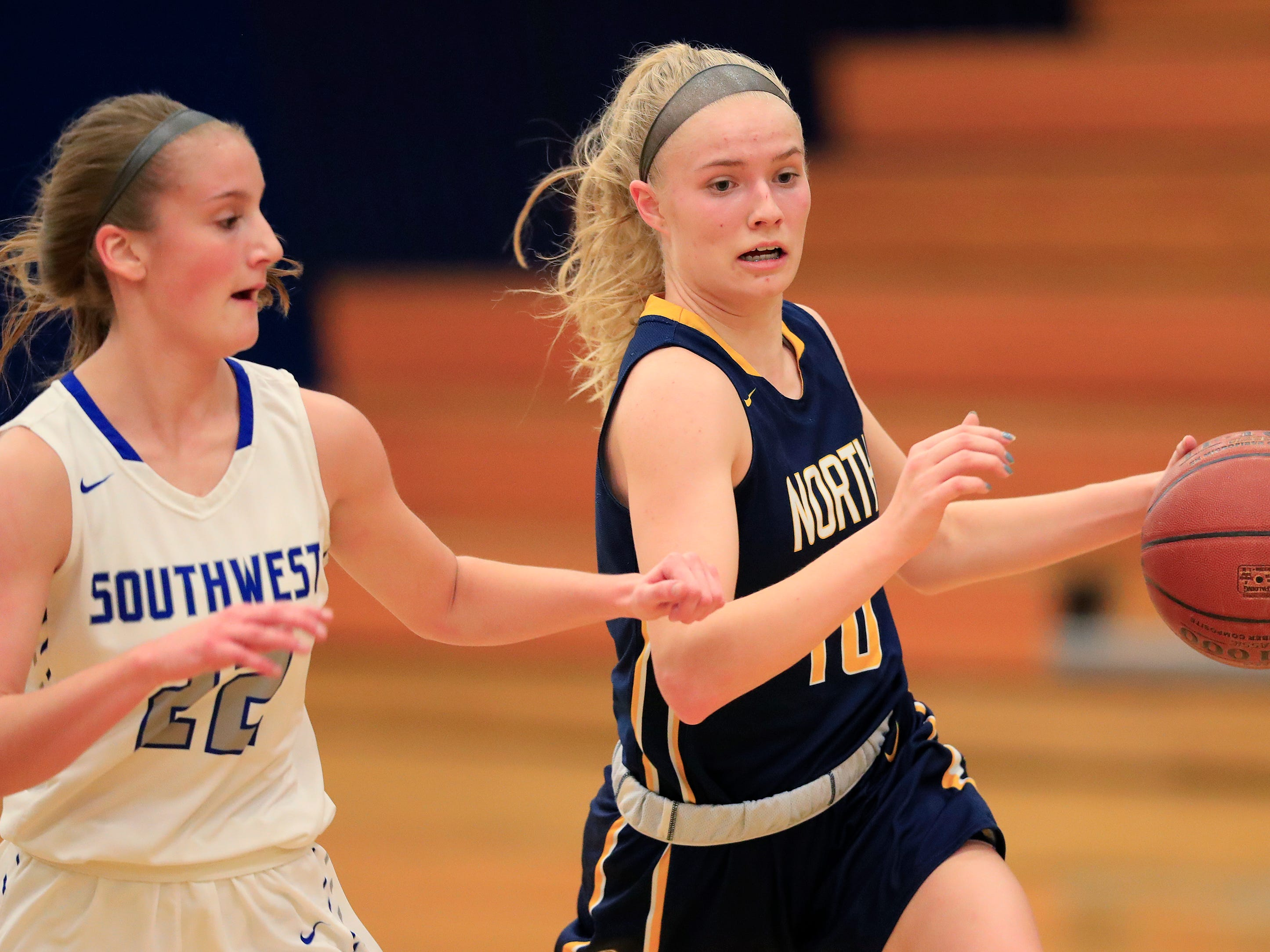 Sheboygan North's Sydney Vogel (10) runs past Green Bay Southwest's Lauren LePine (22) in a girls basketball game at Southwest High School on Tuesday, February 5, 2019 in Green Bay, Wis.