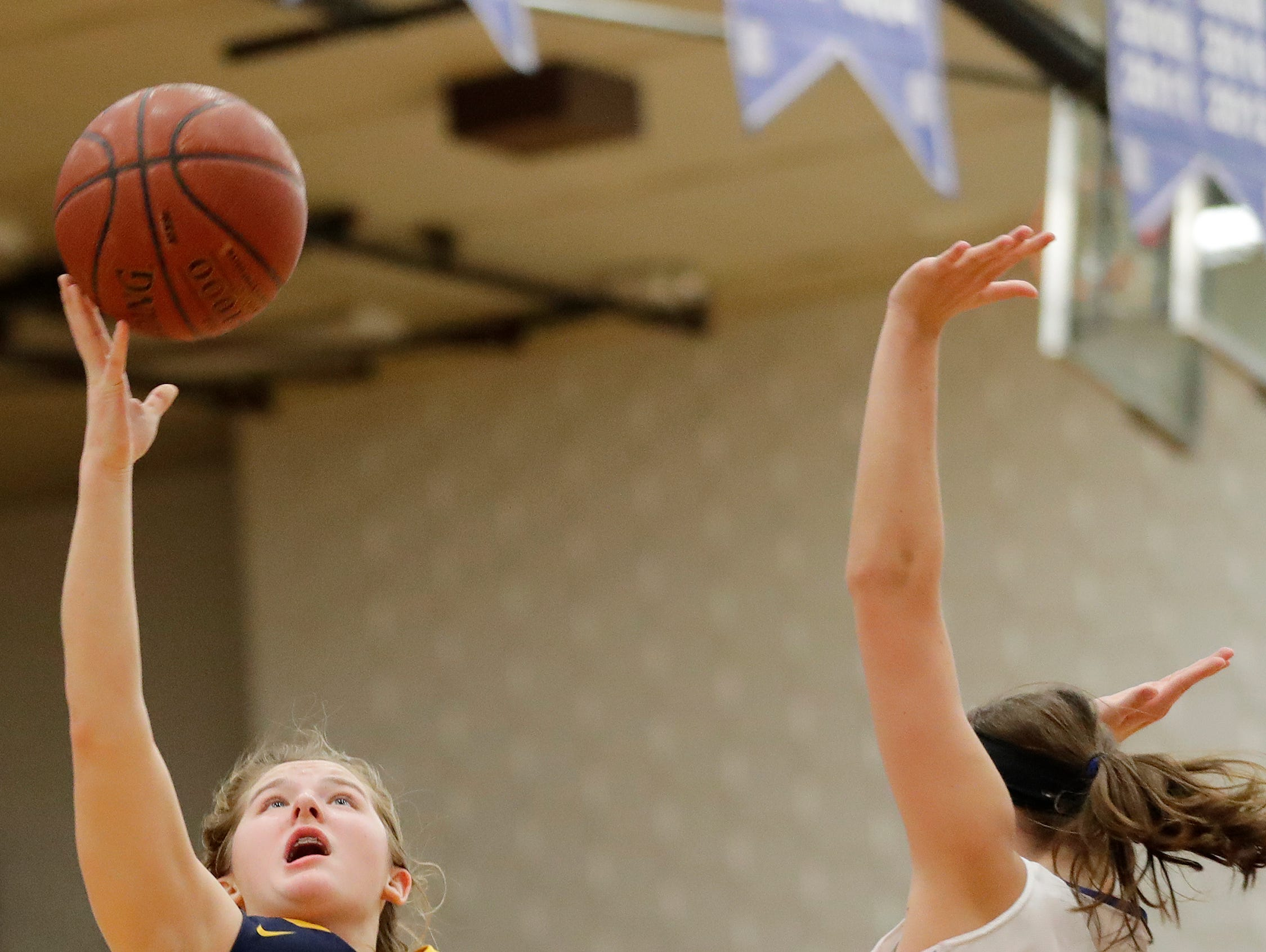 Sheboygan North's Emma Belmore (21) shoots against Green Bay Southwest in a girls basketball game at Southwest High School on Tuesday, February 5, 2019 in Green Bay, Wis.
