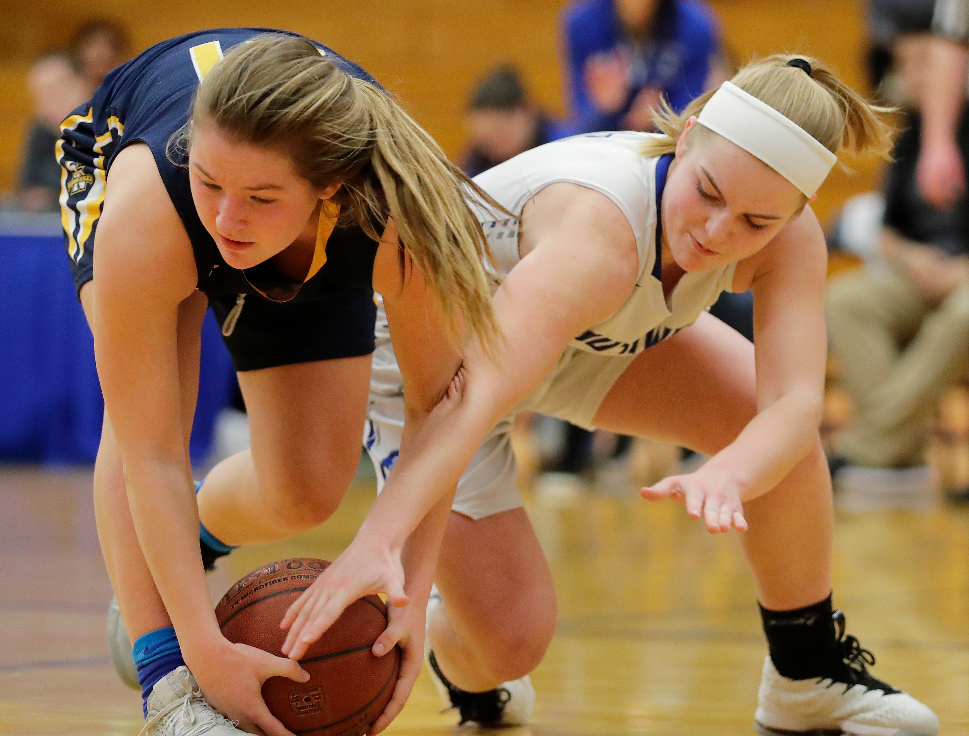 Green Bay Southwest's Kiara Thomas (5) and Sheboygan North's Emma Belmore (21) vie for a loose ball in a girls basketball game at Southwest High School on Tuesday, February 5, 2019 in Green Bay, Wis.
