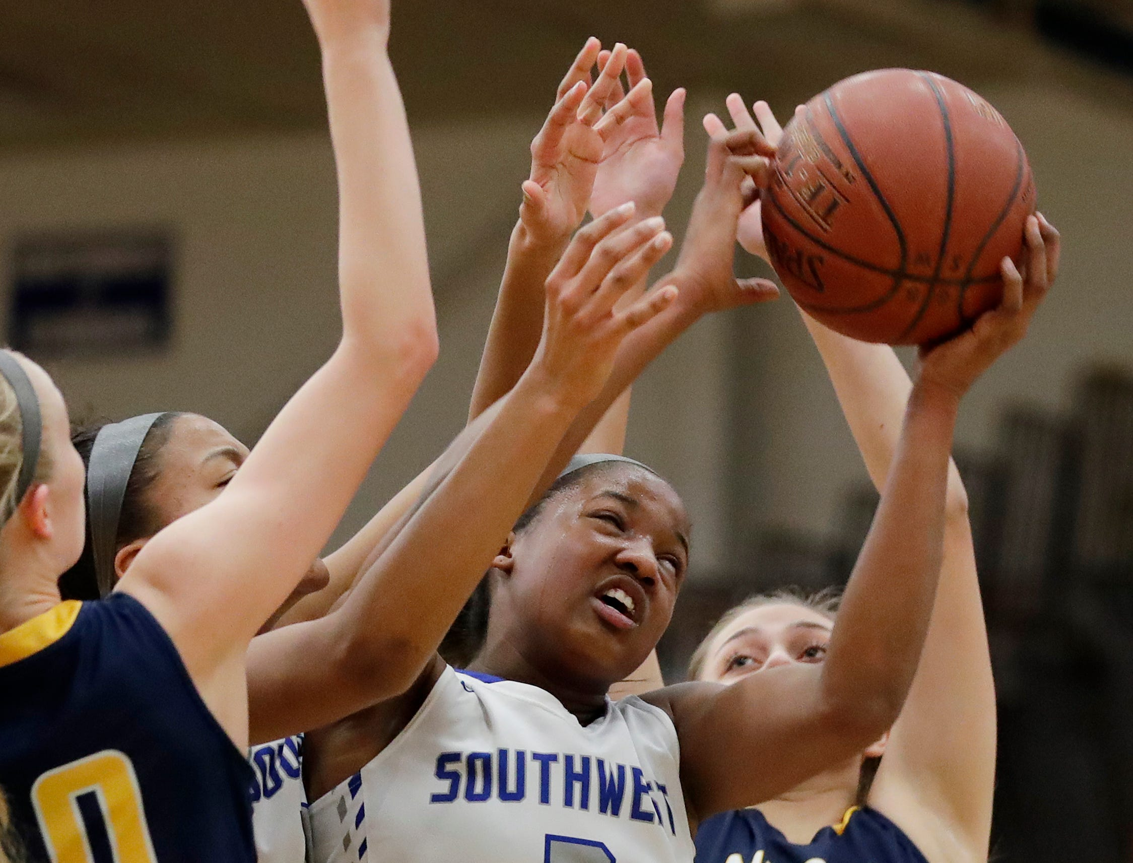 Green Bay Southwest's Jaddan Simmons (2) grabs a rebound against Sheboygan North in a girls basketball game at Southwest High School on Tuesday, February 5, 2019 in Green Bay, Wis.