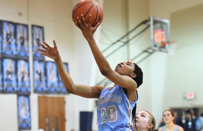 Christ Church Episcopal School's Marissa Powe (20) scores a basket during the game at Southside Christian High School Tuesday, Feb. 5, 2019.