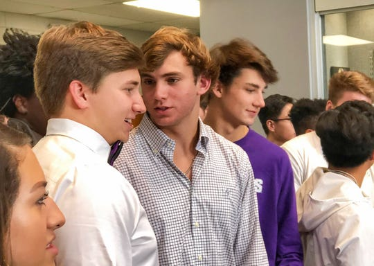 """Jake Kimmelman, right, talks with Southside Christian teammate J. R. Schroeder during a National Signing Day ceremony at the school on Wednesday. Both players will continue their football careers at Furman this fall."""""""