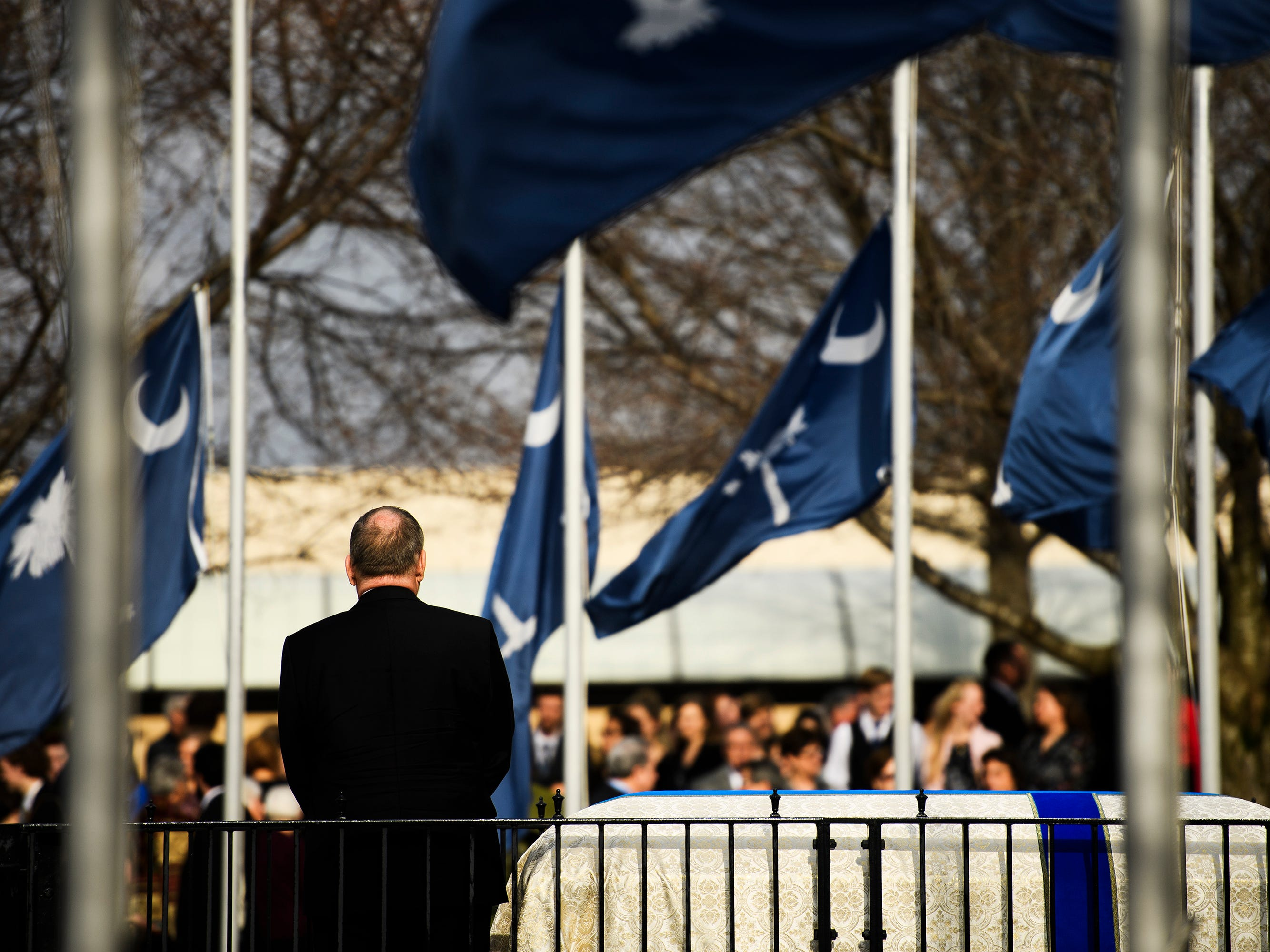 South Carolina state flags fly at half mast as hundreds attend the funeral service of Beneth Peters Jones at Bob Jones University on Wednesday, Feb. 6, 2019.