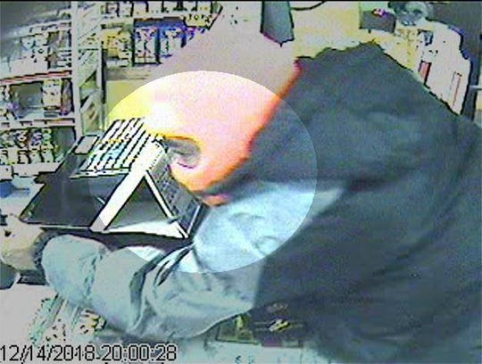 A surveillance photo from B Pam's Food Mart shows one individual involved in a robbery that led to the fatal shooting of a store clerk.