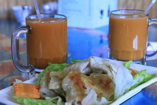 Hot Thai tea and potstickers pair well at the Chinatown Restaurant in Great Falls.
