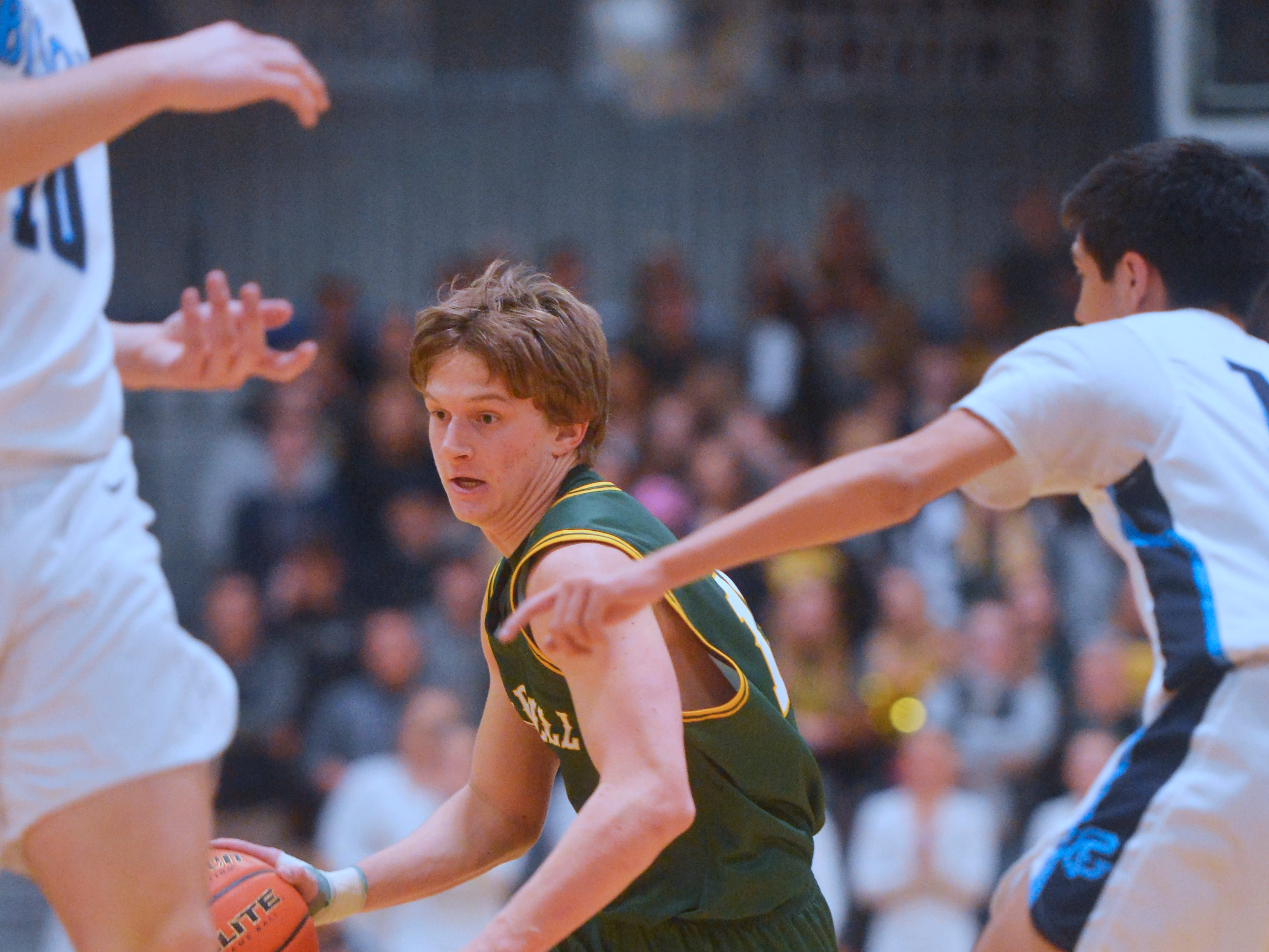 CMR's Cason Taylor looks for an opening in the boys crosstown basketball game against Great Falls High in the Swarthout Fieldhouse, Tuesday.