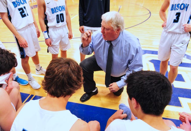 Great Falls High's Bob Howard, center, talks with his players during the second crosstown basketball game Feb. 5 at Swarthout Fieldhouse.