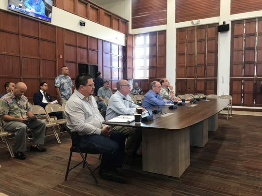 Representatives from the Guam Department of Labor and Guam Contractors Association present their comments and concerns to senators at an informational briefing held on Wednesday, Feb. 6.