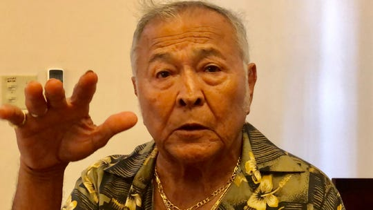 World War II survivor and Vietnam War veteran William M. Roberto Sr., 82, gestures as he recalls life during the Japanese occupation of Guam. Roberto is among nearly 30 war survivors who received an honorary high school diploma in their 70s, 80s, or 90s, based on a 2014 Guam law.
