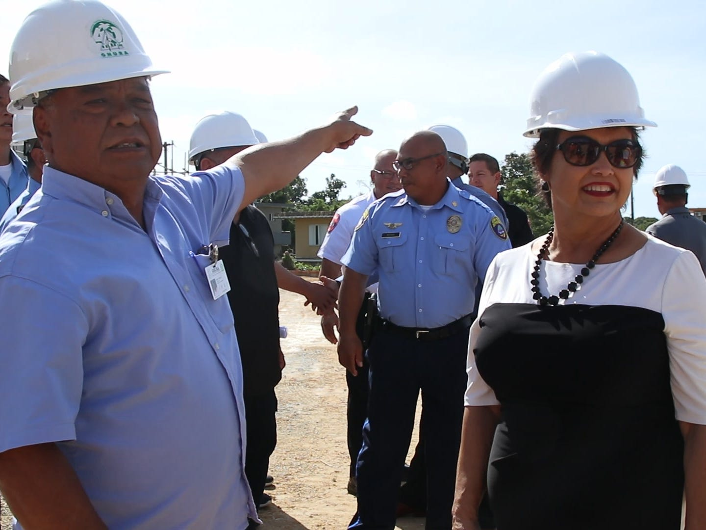 Albert Santos, GHURA architectural and engineering manager, left, guided Gov. Lou Leon Guerrero on a tour of the new central police precinct in Sinajana on Wednesday Feb. 6, 2019.