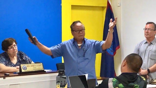 "Sen. Jose ""Pedo"" Terlaje, D-Yona, gestures as he addresses mayors in this 2019 file photo, while Sen. Jim Moylan, right, looks on."