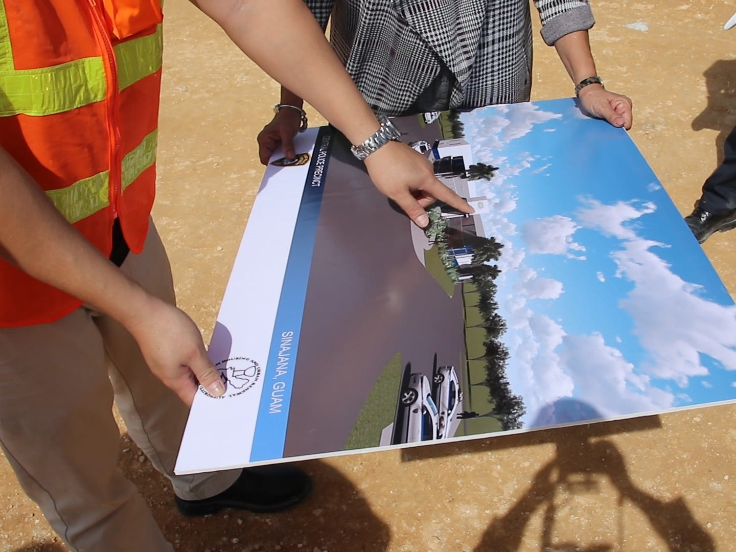 GovGuam workers examine a rendering of the new central police precinct in Sinajana on Wednesday Feb. 6, 2019. The precinct slated to be completely constructed in late March.