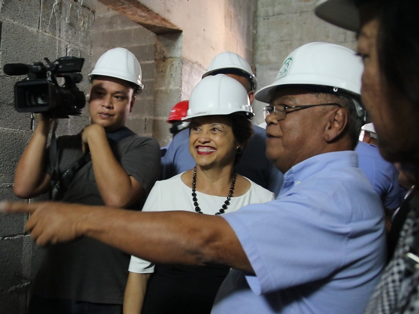 Albert Santos, GHURA architectural and engineering manager, right, guided Gov. Lou Leon Guerrero on a tour of the new central police precinct in Sinajana on Wednesday Feb. 6, 2019. Santos projected the precinct to be complete by Late March this year.