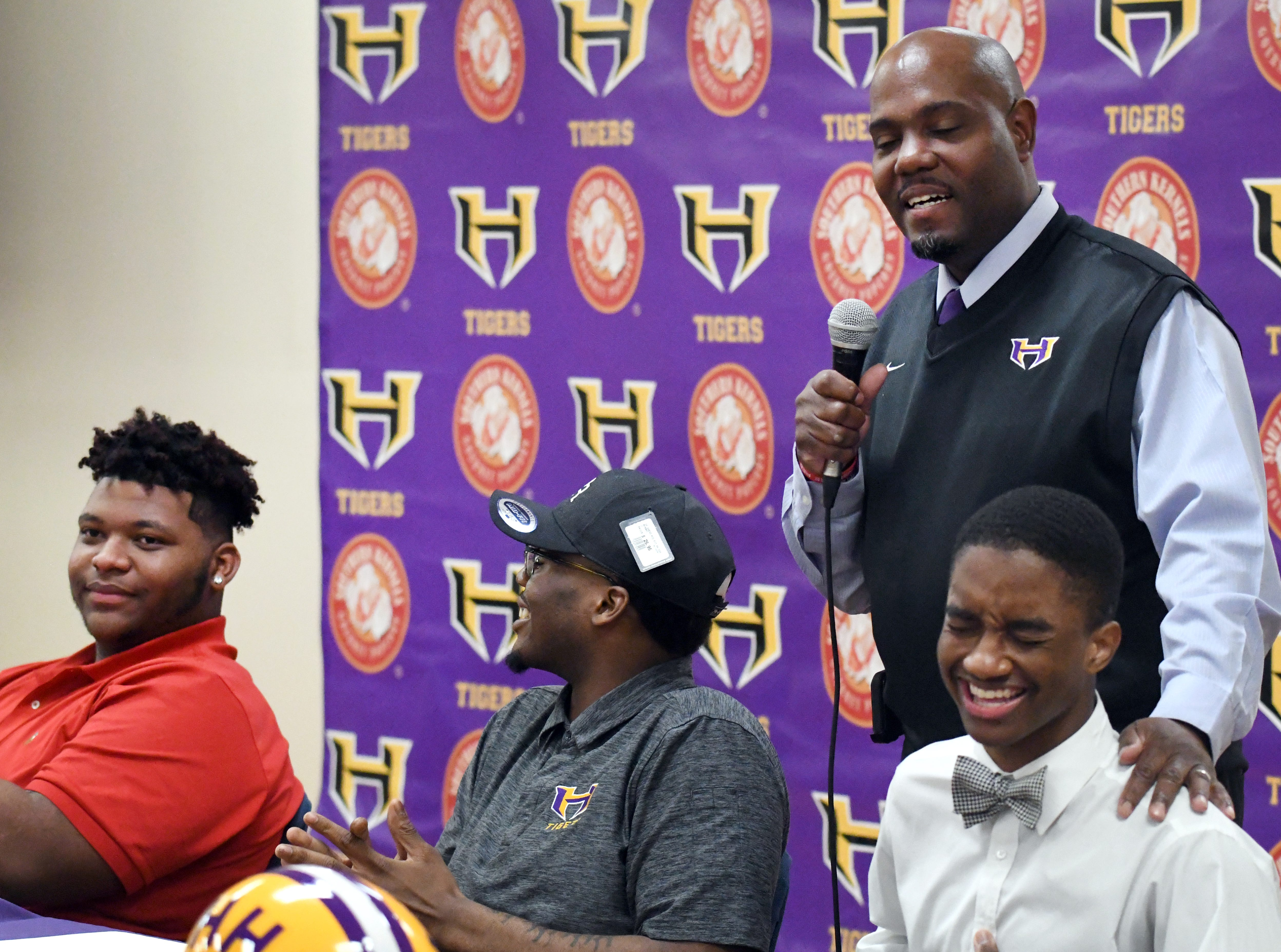 Hattiesburg High head coach Tony Vance congratulates his athletes during National Signing Day in Hattiesburg on Wednesday, February 6, 2019.