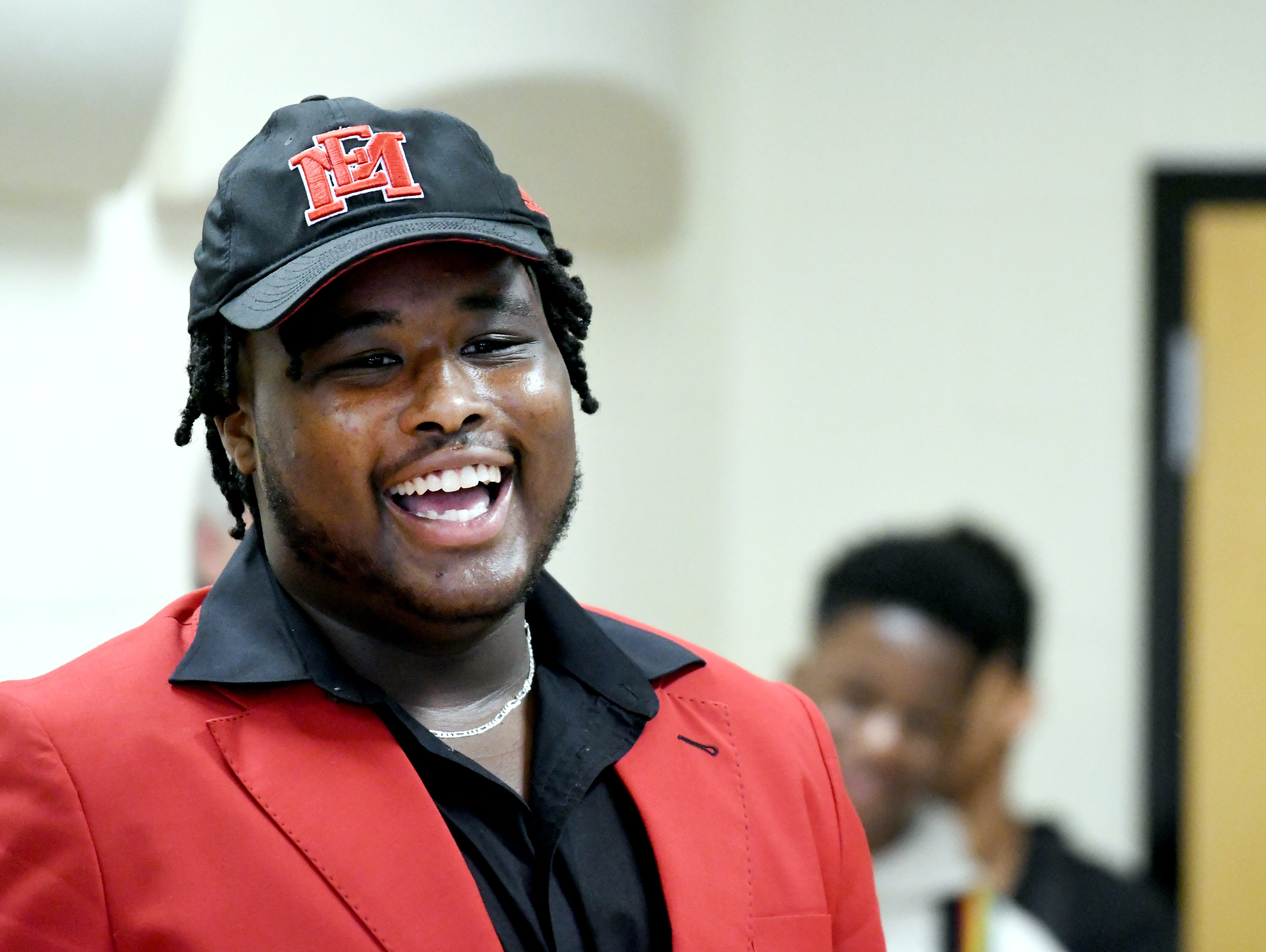 Oak Grove athlete Kaleb Carter commits to East Mississippi Community College during National Signing Day in Hattiesburg on Wednesday, February 6, 2019.
