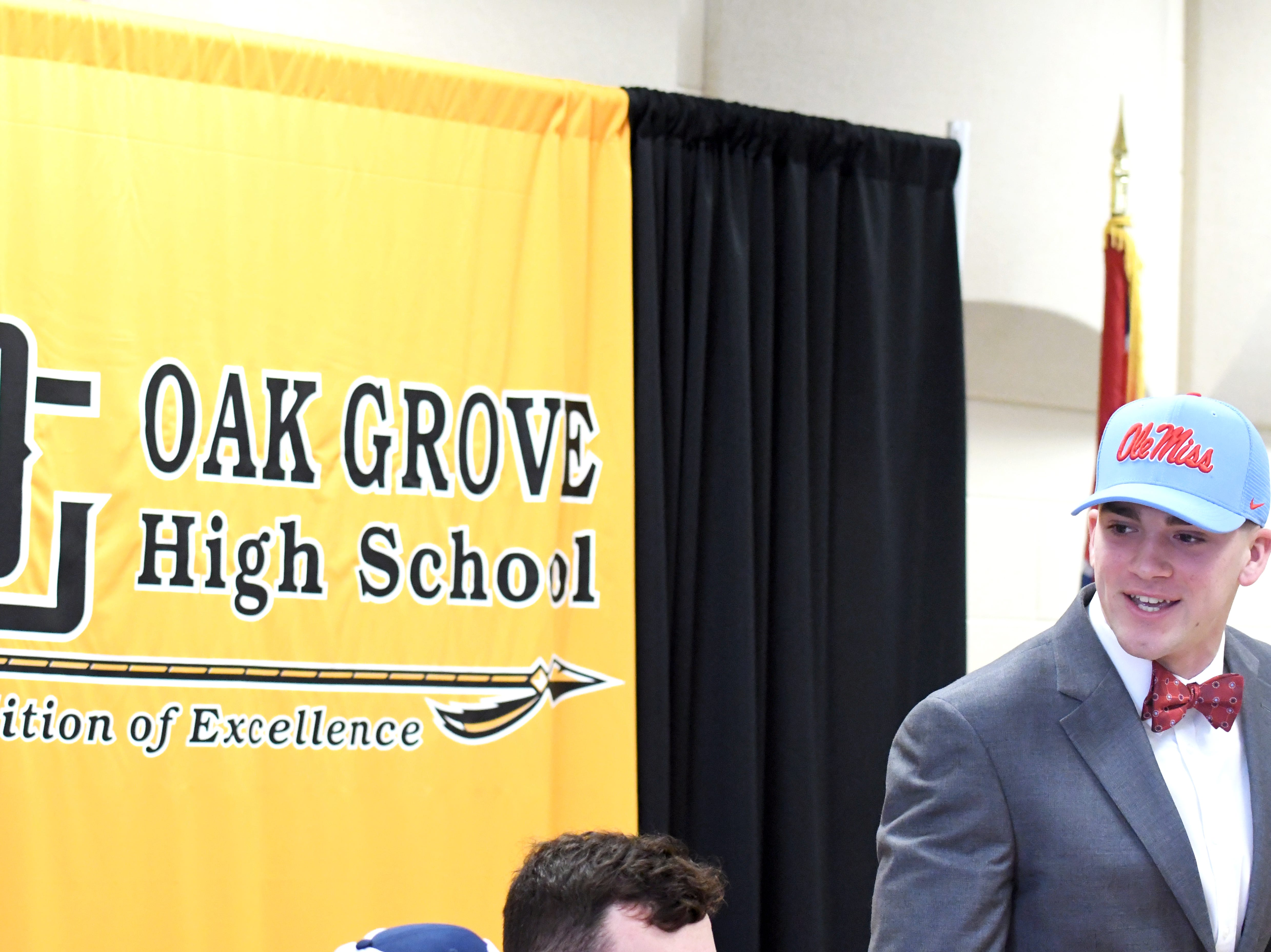 Oak Grove quarterback John Rhys Plumlee committed to Ole Miss on National Signing Day to play both football and baseball.