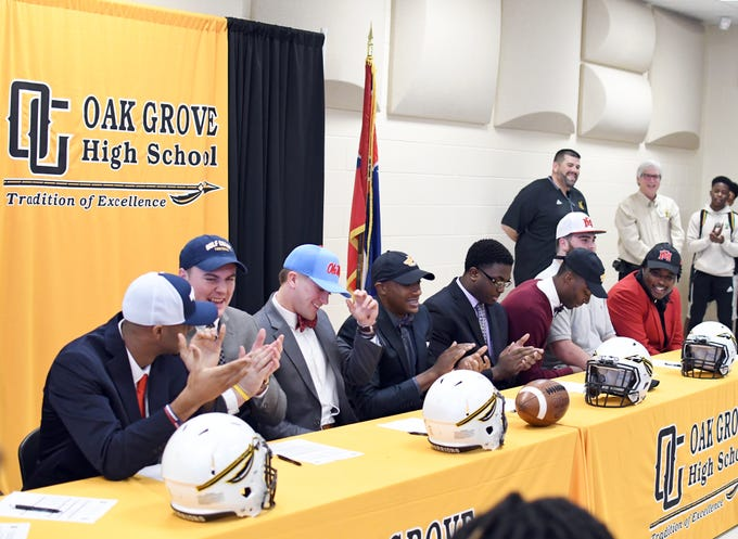 Ten Oak Grove seniors committed to their future colleges to play football during National Signing Day in Hattiesburg on Wednesday, February 6, 2019.