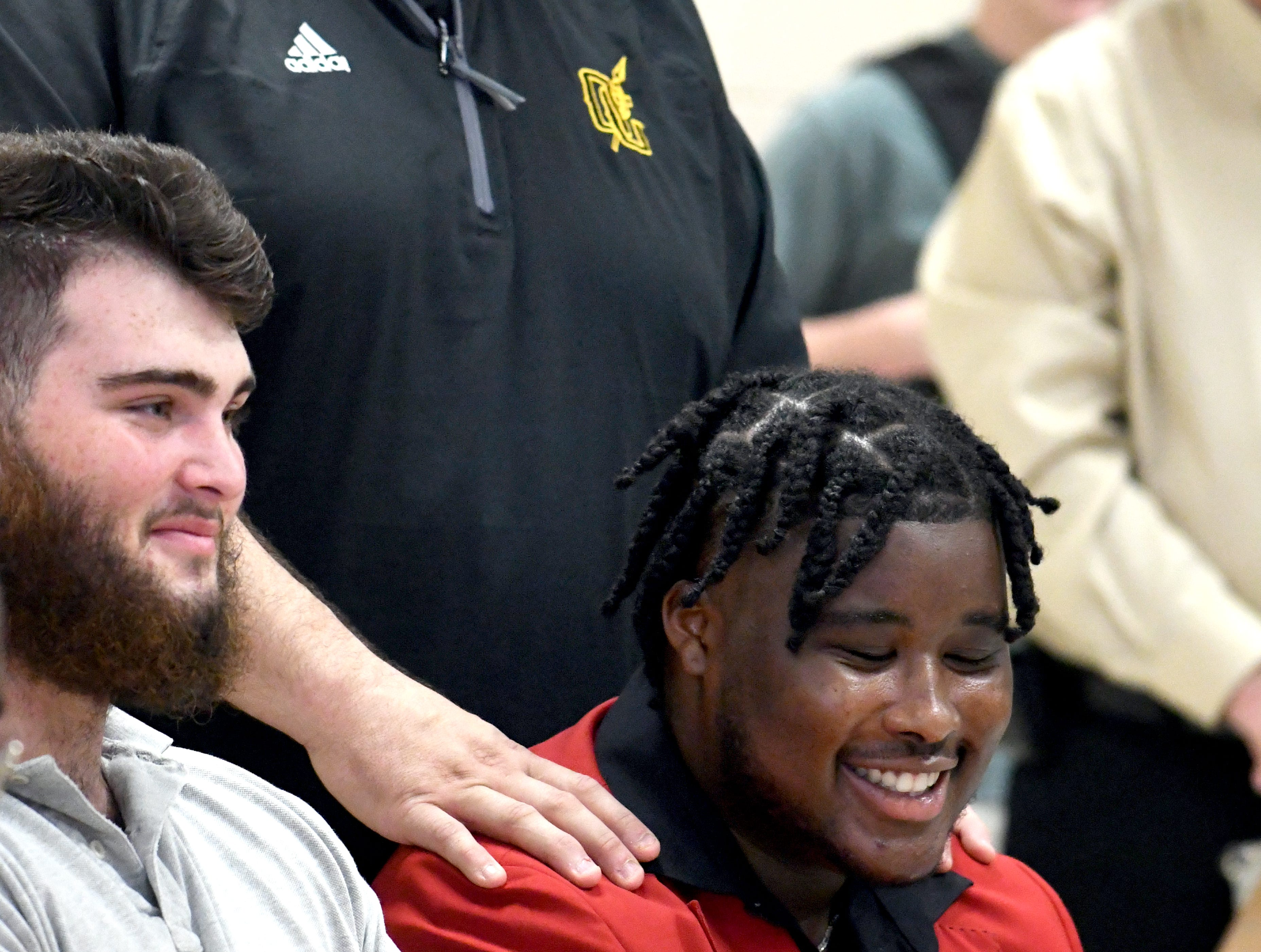 Oak Grove head football coach Drew Causey speaks about athlete Kaleb Carter during National Signing Day in Hattiesburg on Wednesday, February 6, 2019.
