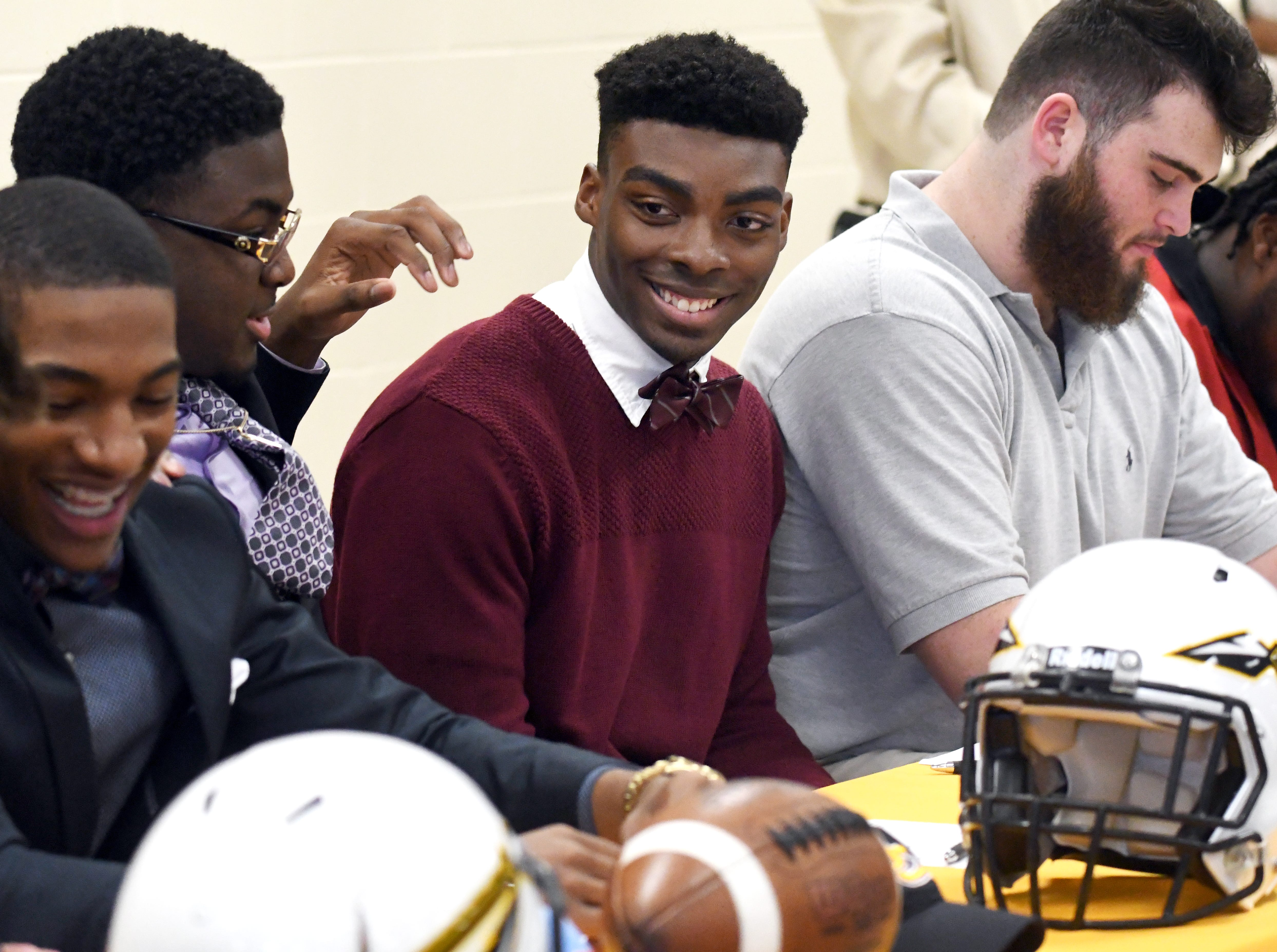 Oak Grove athlete Johnny Magee commits to Jone County Junior College to play football during National Signing Day in Hattiesburg on Wednesday, February 6, 2019.