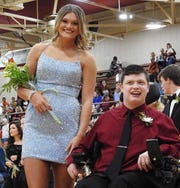 Homecoming Queen Hannah Watkins poses with classmate Seth Liles.
