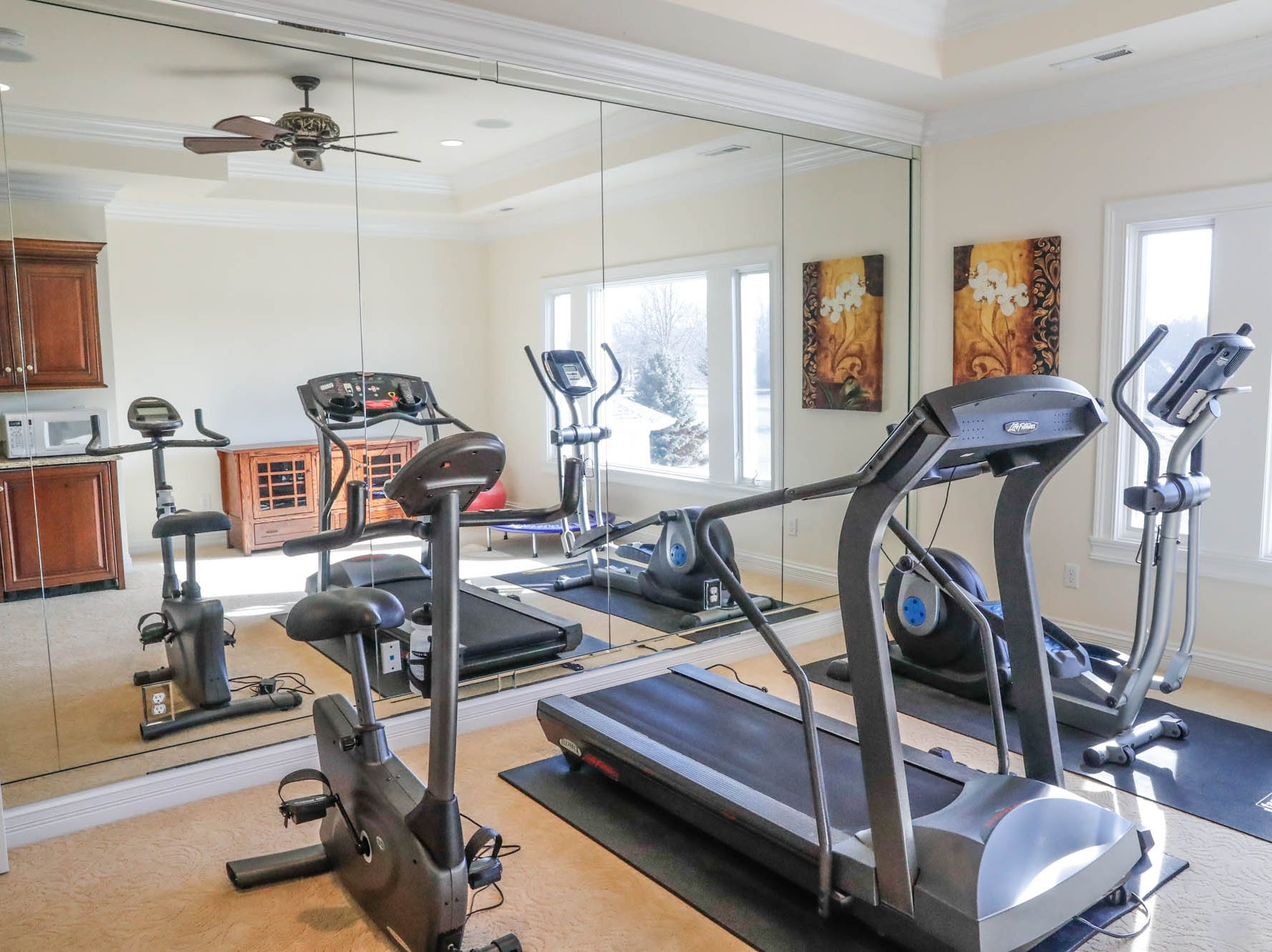 A second-floor workout room/dance studio offers a place to stay fit at a Greenwood home up for sale at 1216 Stone Ridge Court, Greenwood, Ind. on Wednesday, Jan. 30, 2019. The home features 8,234 square feet, four bedrooms, two master suites, a 10 car garage, and an exercise room.