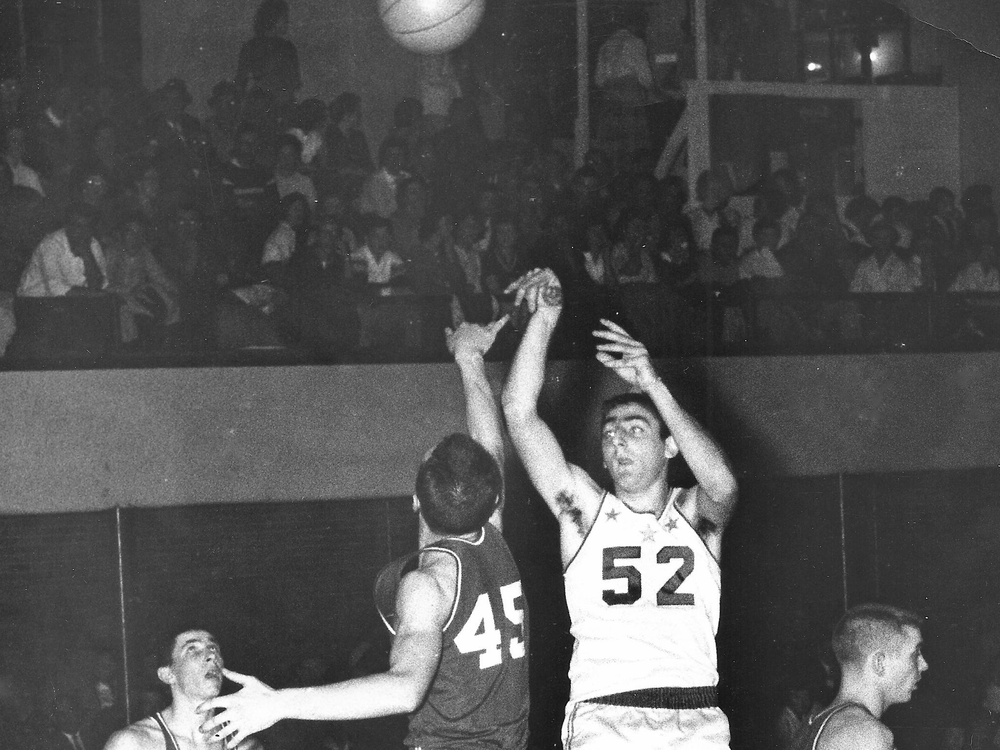 Marion Pierce, No. 52 of Lewisville, set a high school scoring record in 1961 with 3,019 during his high school basketball days in the 1960s