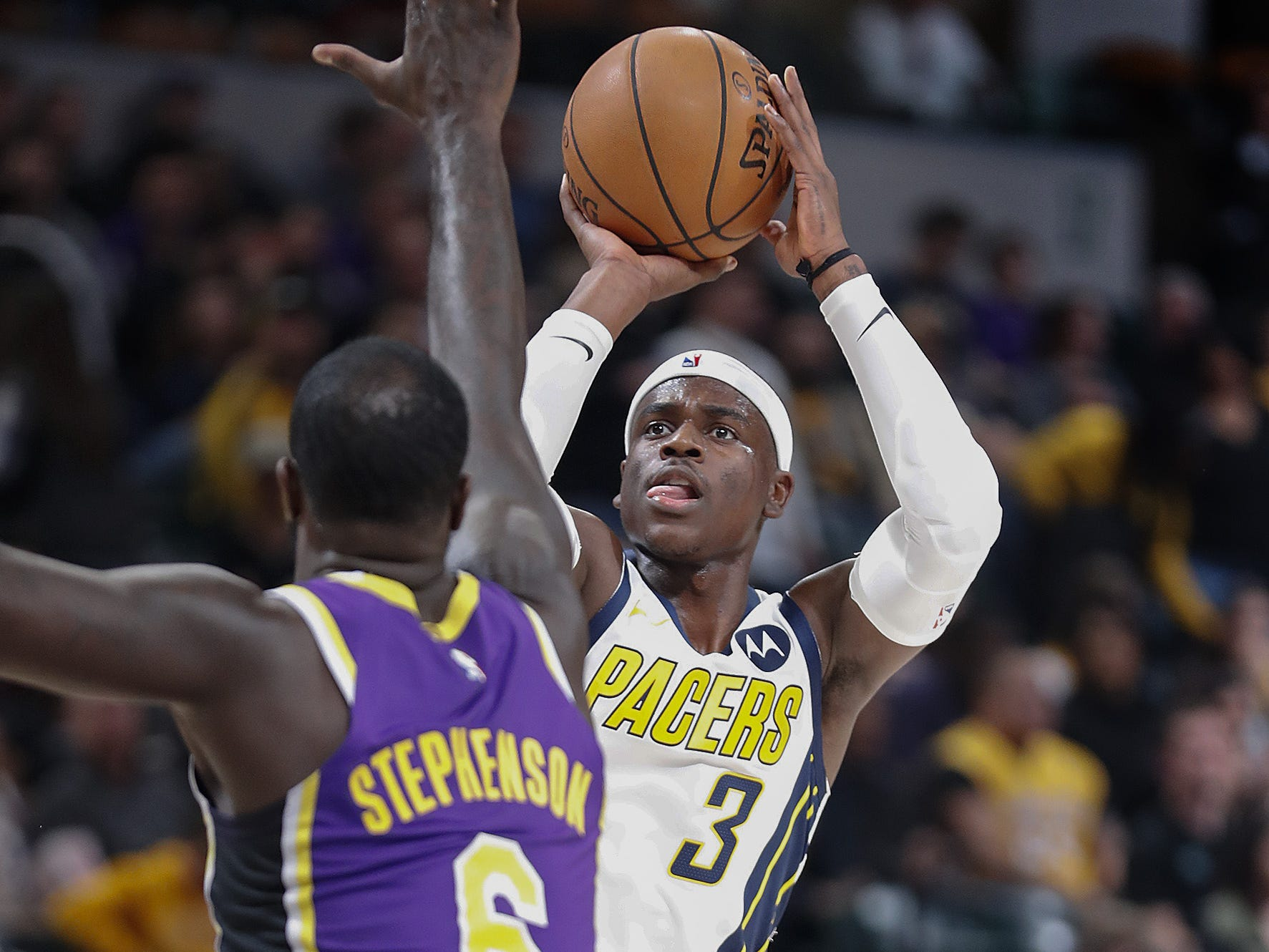 Indiana Pacers guard Aaron Holiday (3) shoots a three-pointer over Los Angeles Lakers guard Lance Stephenson (6) in the second half of their game at Bankers Life Fieldhouse on Tuesday, Feb. 5, 2019.