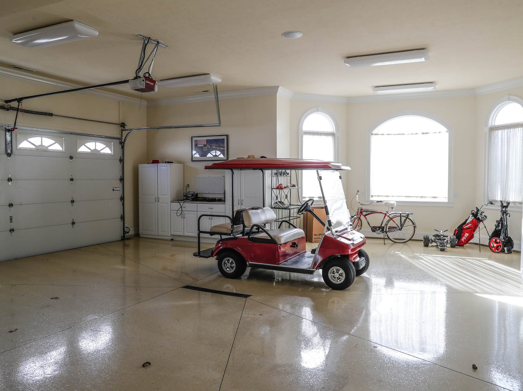 A Greenwood home up for sale at 1216 Stone Ridge Court, Greenwood, Ind., features an attached four car garage with custom epoxy floor, on Wednesday, Jan. 30, 2019. The home features 8,234 square feet, four bedrooms, two master suits, a 10 car garage, and exercise room.