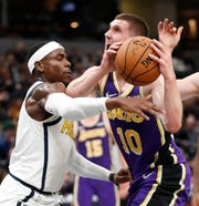 Indiana Pacers guard Aaron Holiday (3) knocks the ball away from Los Angeles Lakers guard Sviatoslav Mykhailiuk (10) in the second half of their game at Bankers Life Fieldhouse on Tuesday, Feb. 5, 2019.