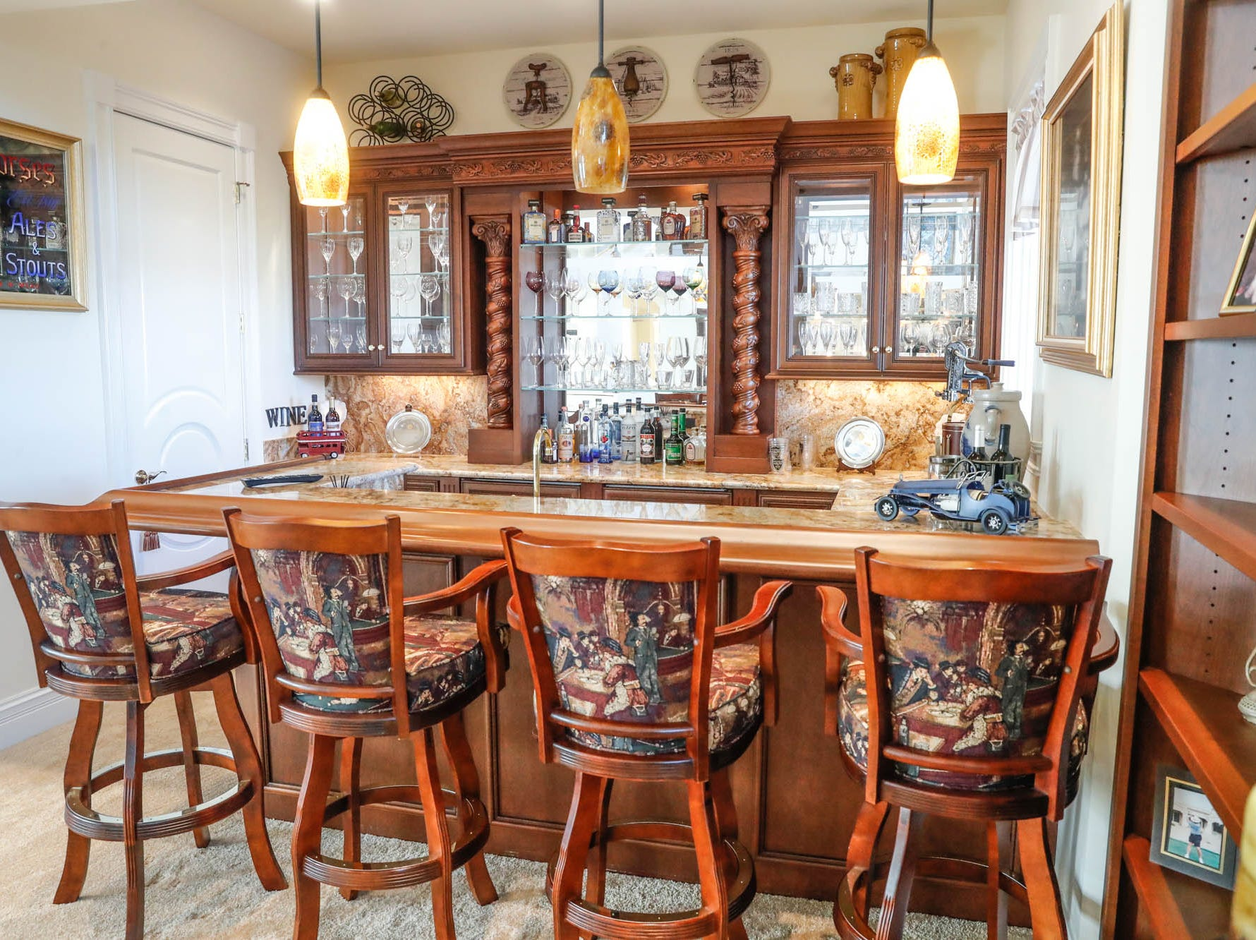 A Greenwood home up for sale at 1216 Stone Ridge Court, Greenwood, Ind., features a bar in the open living room on Wednesday, Jan. 30, 2019. The home features 8,234 square feet, four bedrooms, two master suits, a 10 car garage, and exercise room.