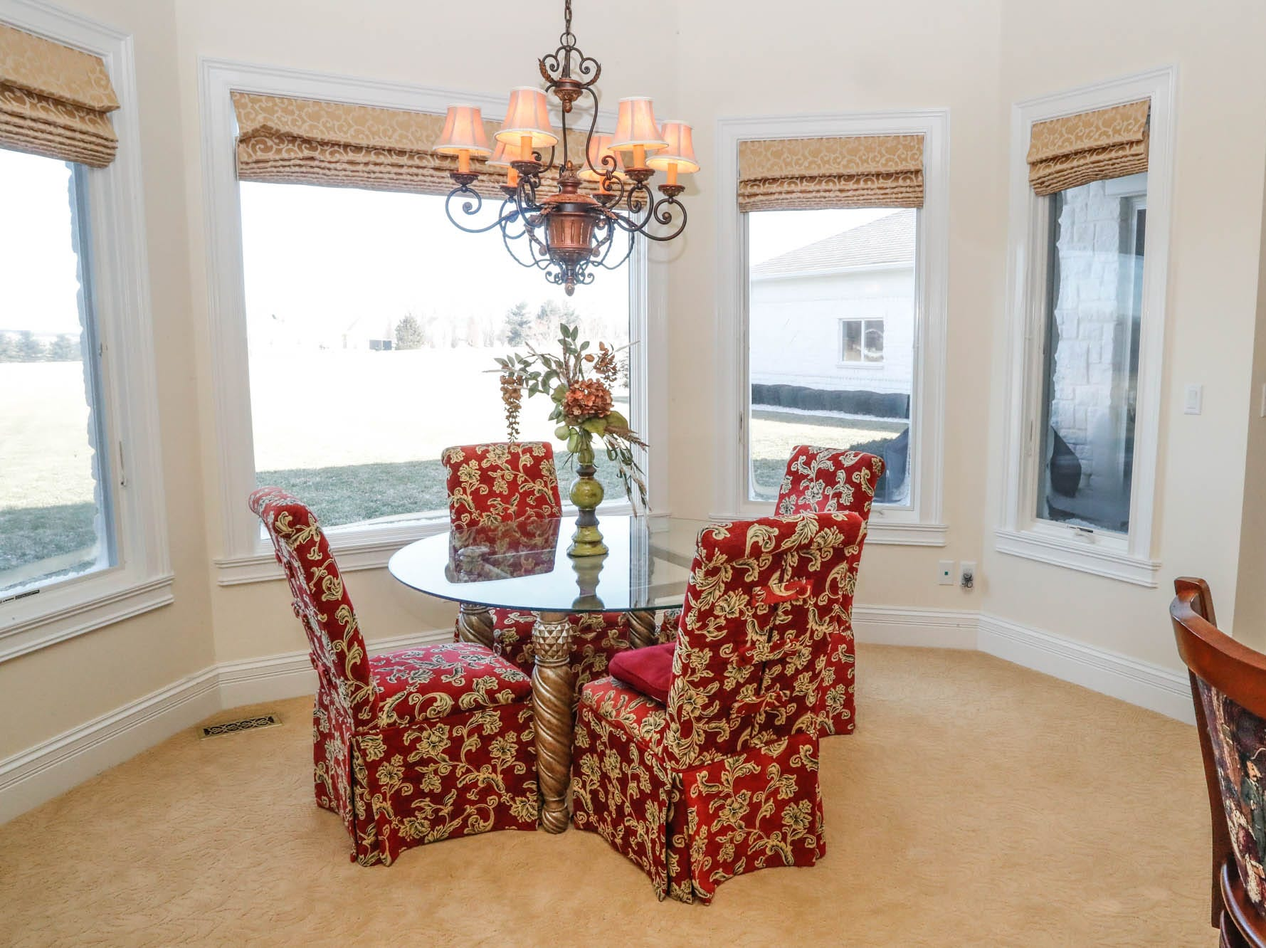 A breakfast nook overlooks over six acres of property at a Greenwood home up for sale at 1216 Stone Ridge Court, Greenwood, Ind. on Wednesday, Jan. 30, 2019. The home features 8,234 square feet, four bedrooms, two master suits, a 10 car garage, and exercise room.