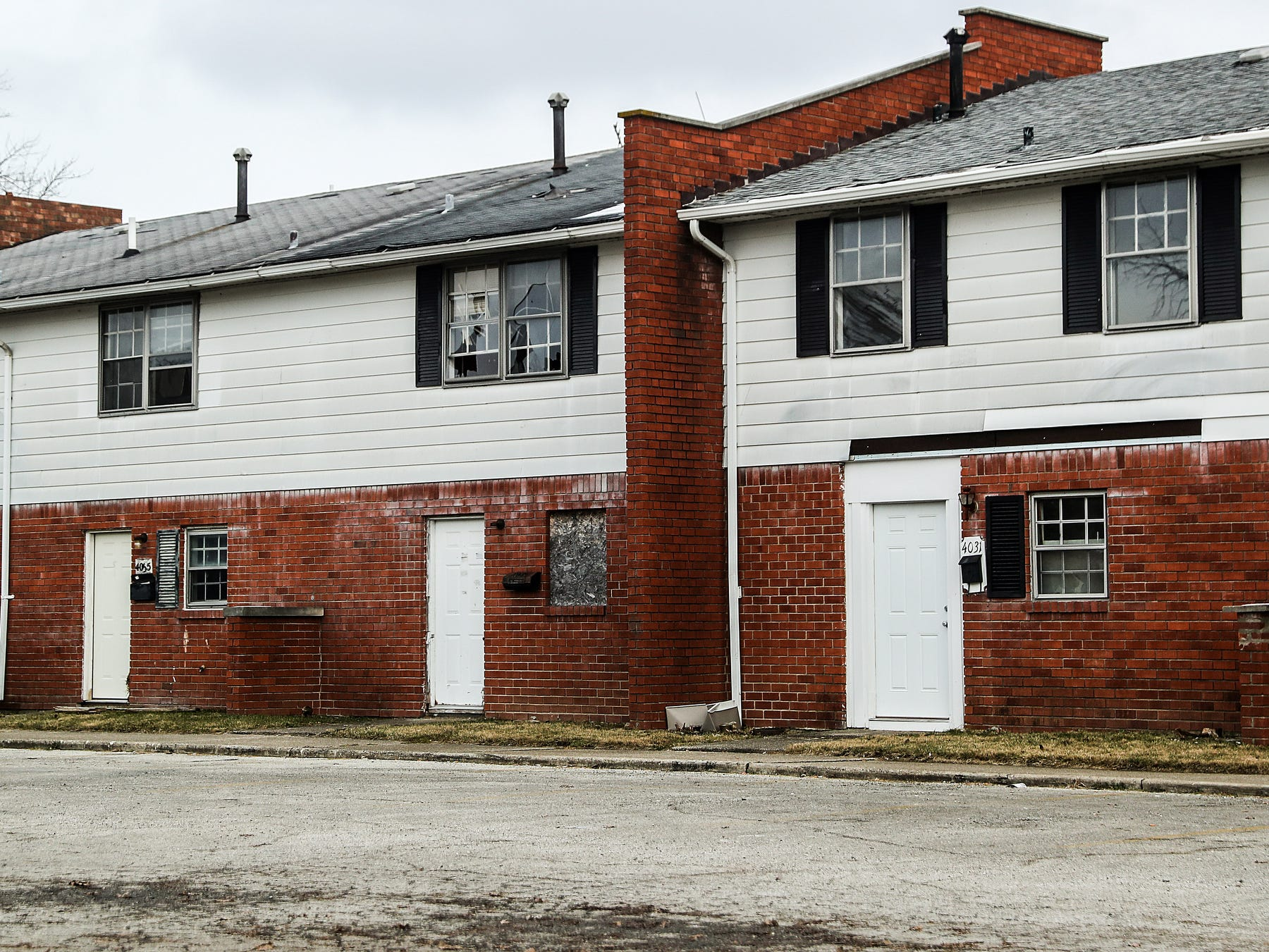 At Towne and Terrace, a housing complex built in the 1960s off of 42nd Street and Post Road, half of the deteriorating 222 units are empty or abandoned, seen Saturday, Dec. 8, 2018. As Fort Benjamin Harrison military base closed in 1991 and working-class residents left the area, housing providers lowered prices to attract people to the north-east side. Over time, the complex has become concentrated with systematic problems like drug-dealing and violence. Since 2013, seven criminal homicide victims have been found at the complex.