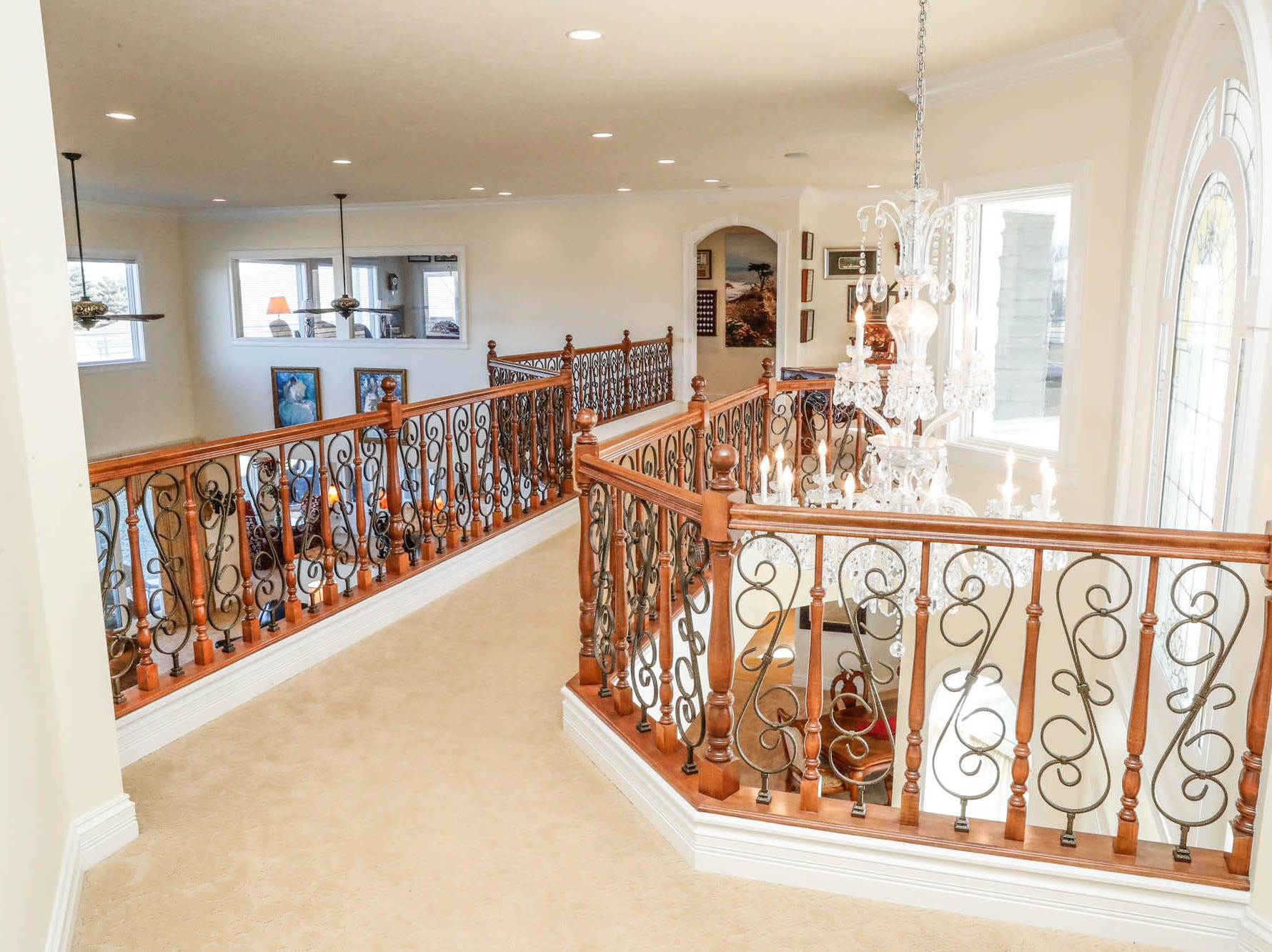 A walkway leads from a master suite to an upstairs billiards space at a Greenwood home up for sale at 1216 Stone Ridge Court, Greenwood, Ind. on Wednesday, Jan. 30, 2019. The home features 8,234 square feet, four bedrooms, two master suites, a 10 car garage, and an exercise room.