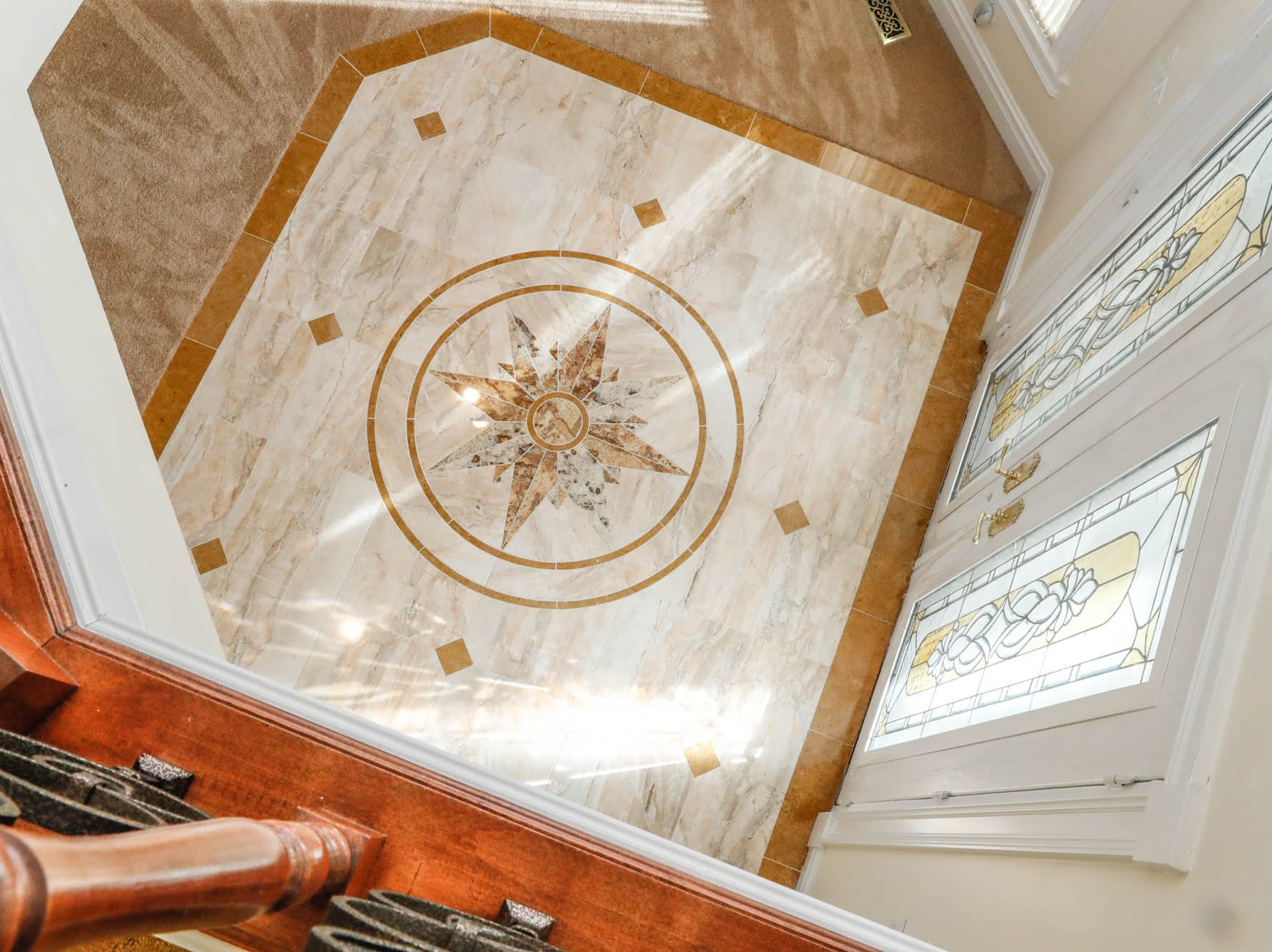 A Greenwood home up for sale at 1216 Stone Ridge Court, Greenwood, Ind., features an intricate entrance way on Wednesday, Jan. 30, 2019. The home features 8,234 square feet, four bedrooms, two master suites, a 10 car garage, and an exercise room.